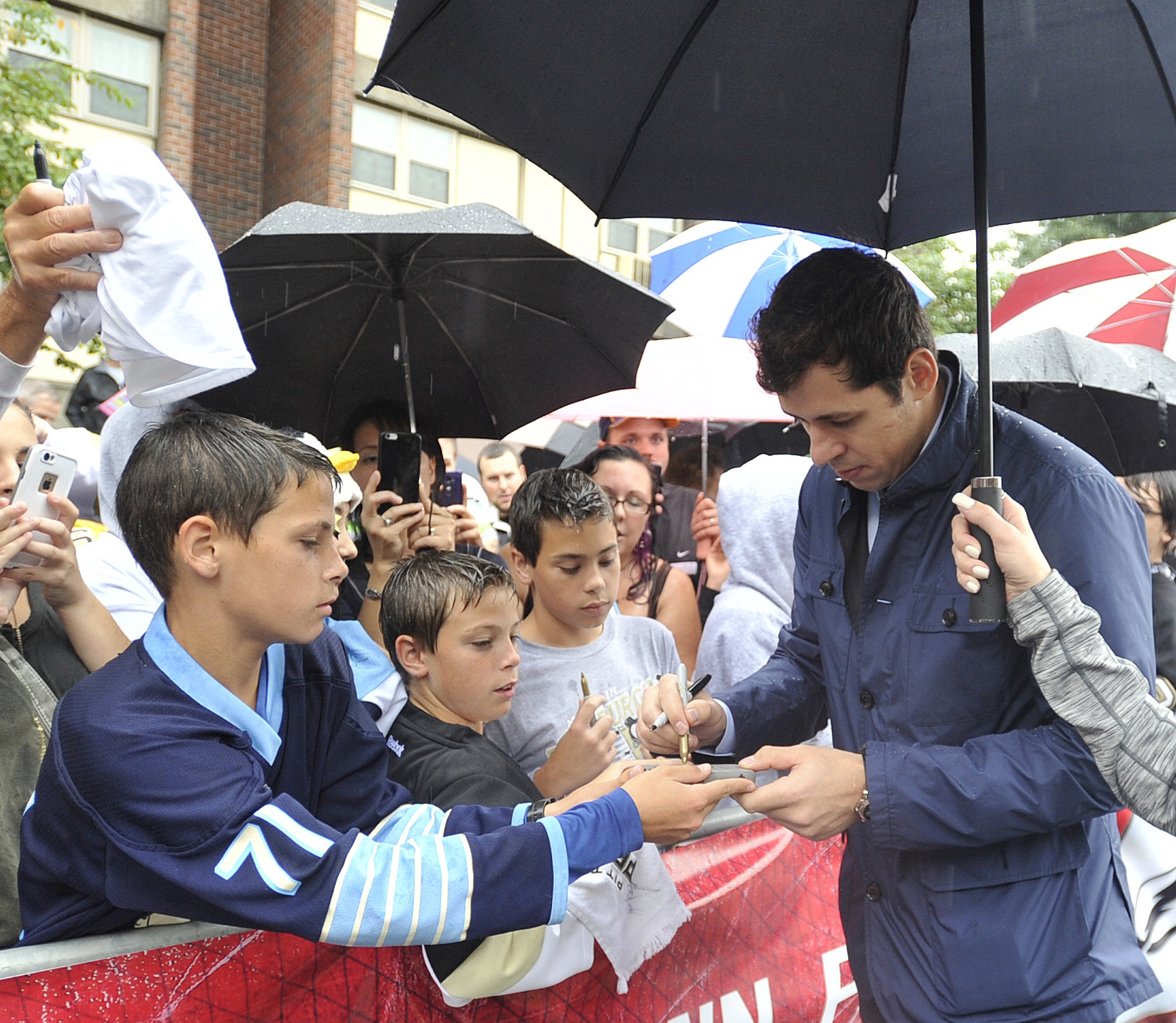 Pittsburgh Penguins Evgeni Malkin signs autographs before the morning skate at Johnstown, Pa., on Tuesday, Sept. 29, 2015.   The Penguins will face the Tampa Bay Lighting in a pre-season NHL hockey game. (Todd Berkey/The Tribune-Democrat via AP) MANDATORY