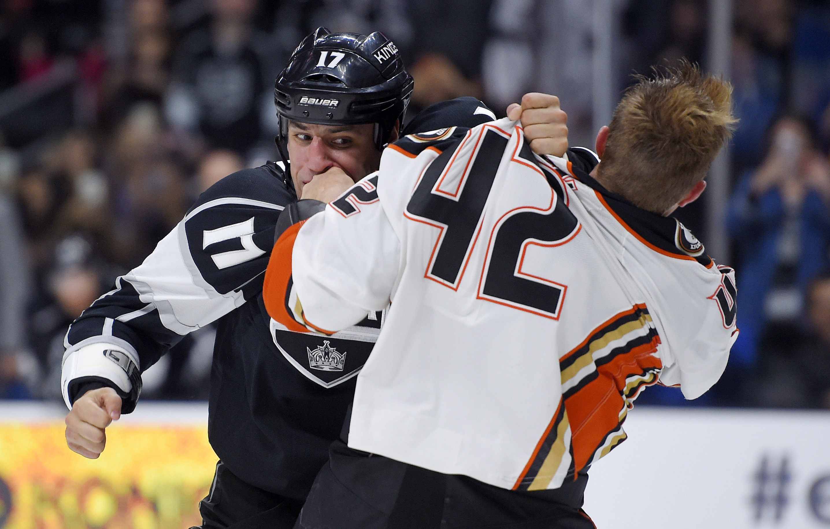 Los Angeles Kings left wing Milan Lucic, left, fights with Anaheim Ducks defenseman Josh Manson during the second period of a preseason NHL hockey game Tuesday, Sept. 29, 2015, in Los Angeles. (AP Photo/Mark J. Terrill)