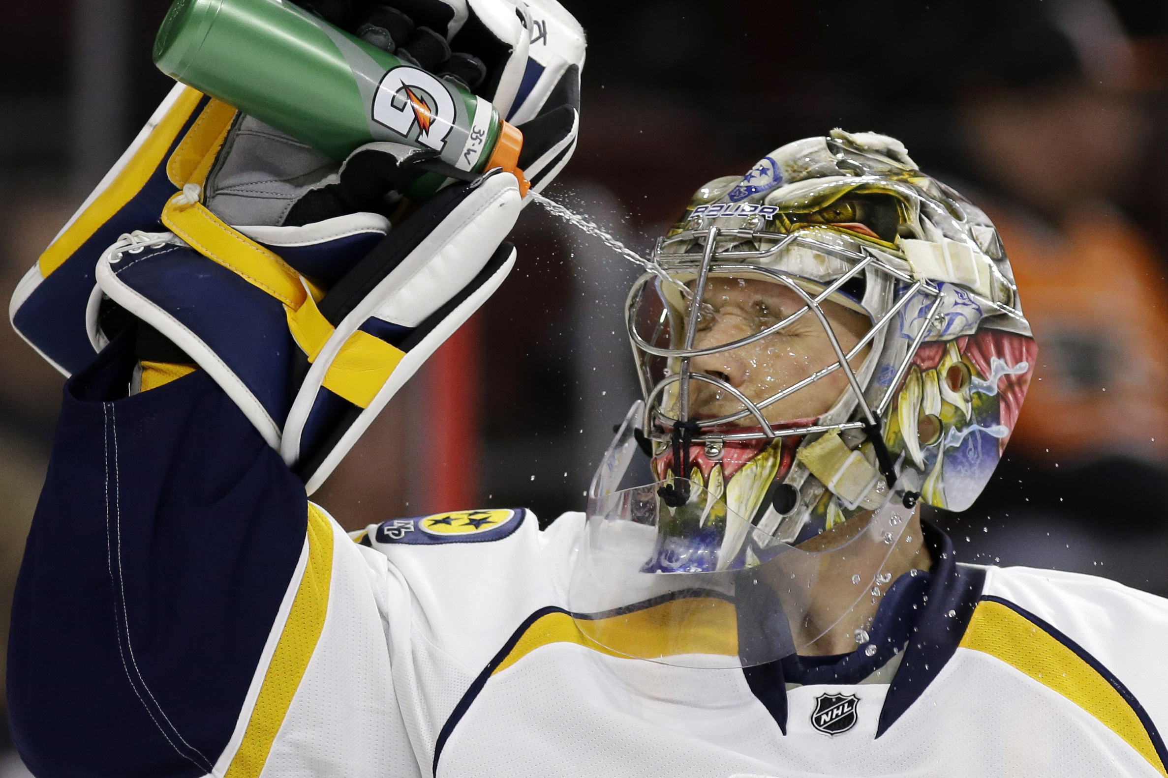 FILE - In this Feb. 21, 2015, file photo, Nashville Predators' Pekka Rinne, of Finland, squirts himself with water before the second period of an NHL hockey game against the Philadelphia Flyers in Philadelphia. Speculation started even before the Nashvill