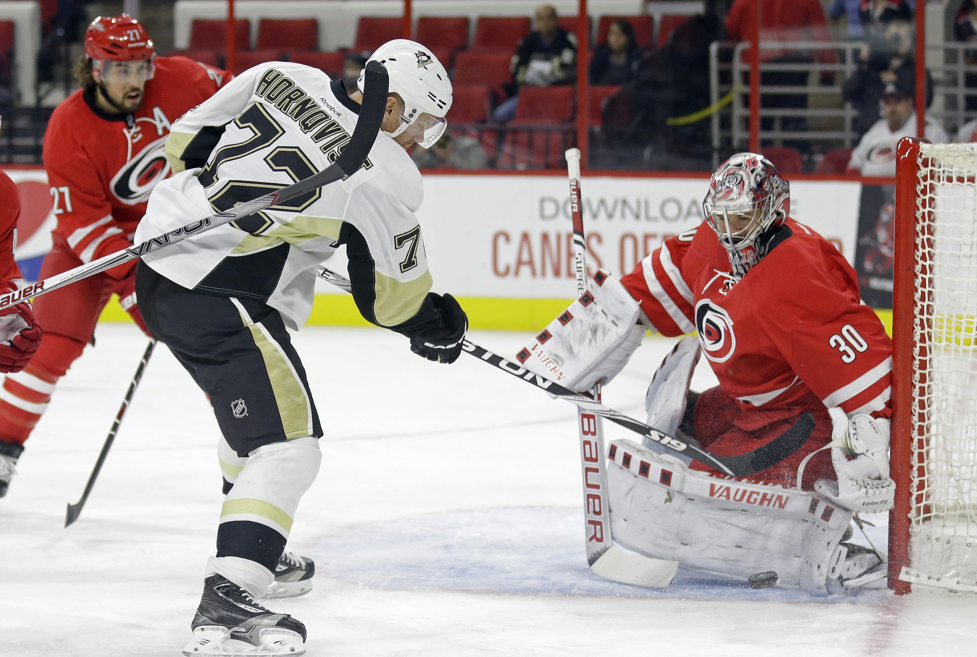 Carolina Hurricanes goalie Cam Ward (30) defends against Pittsburgh Penguins' Patric Hornqvist (72), of Sweden, during the first period of an NHL preseason hockey game in Raleigh, N.C., Friday, Oct. 2, 2015. (AP Photo/Gerry Broome)