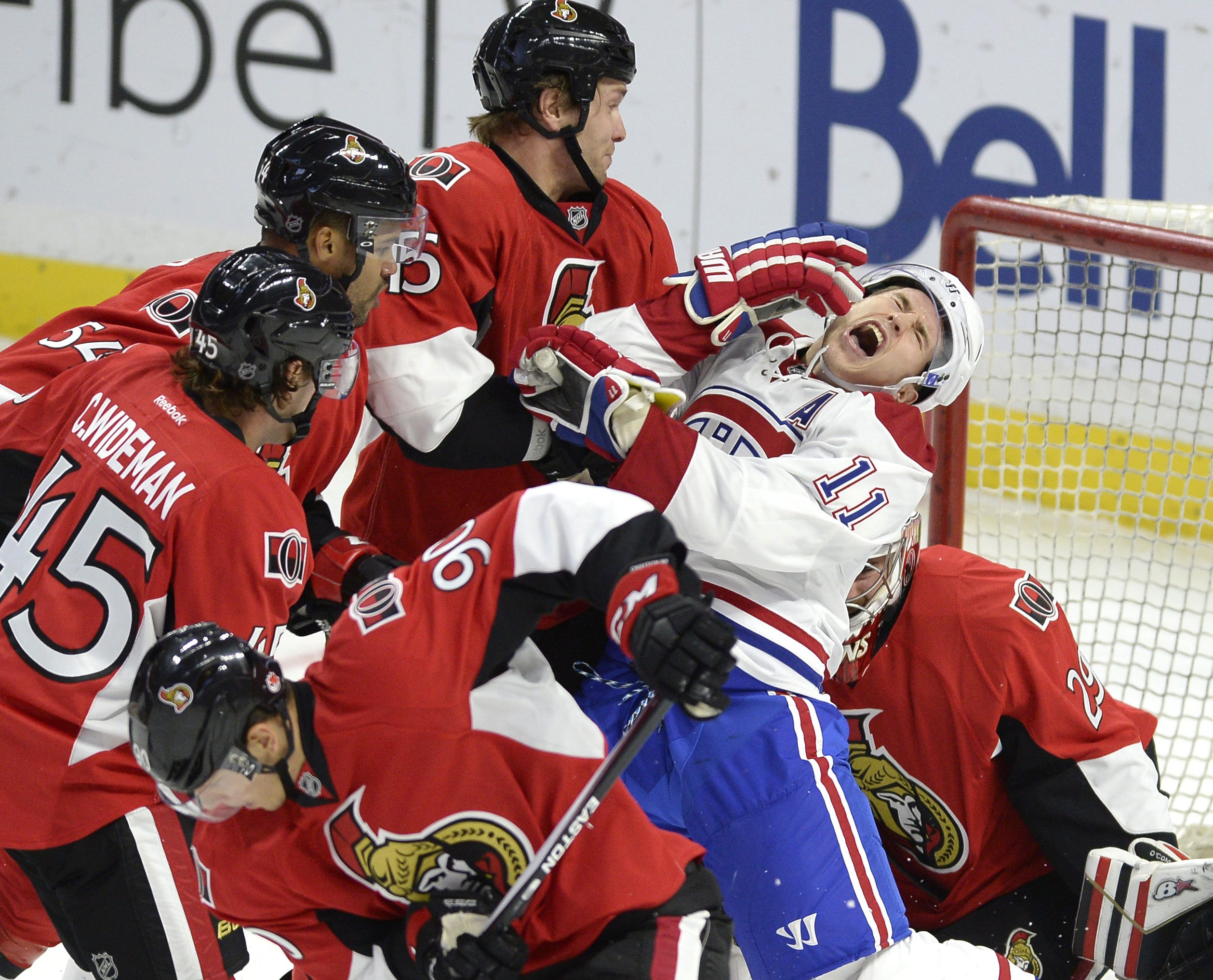 Montreal Canadiens' Brendan Gallagher (11) reacts as Ottawa Senators' Zack Smith (15) draws a roughing penalty in the Senators crease during the first period of a pre-season NHL hockey game, Saturday Oct. 3, 2015, in Ottawa, Ontario. (Justin Tang /The Can