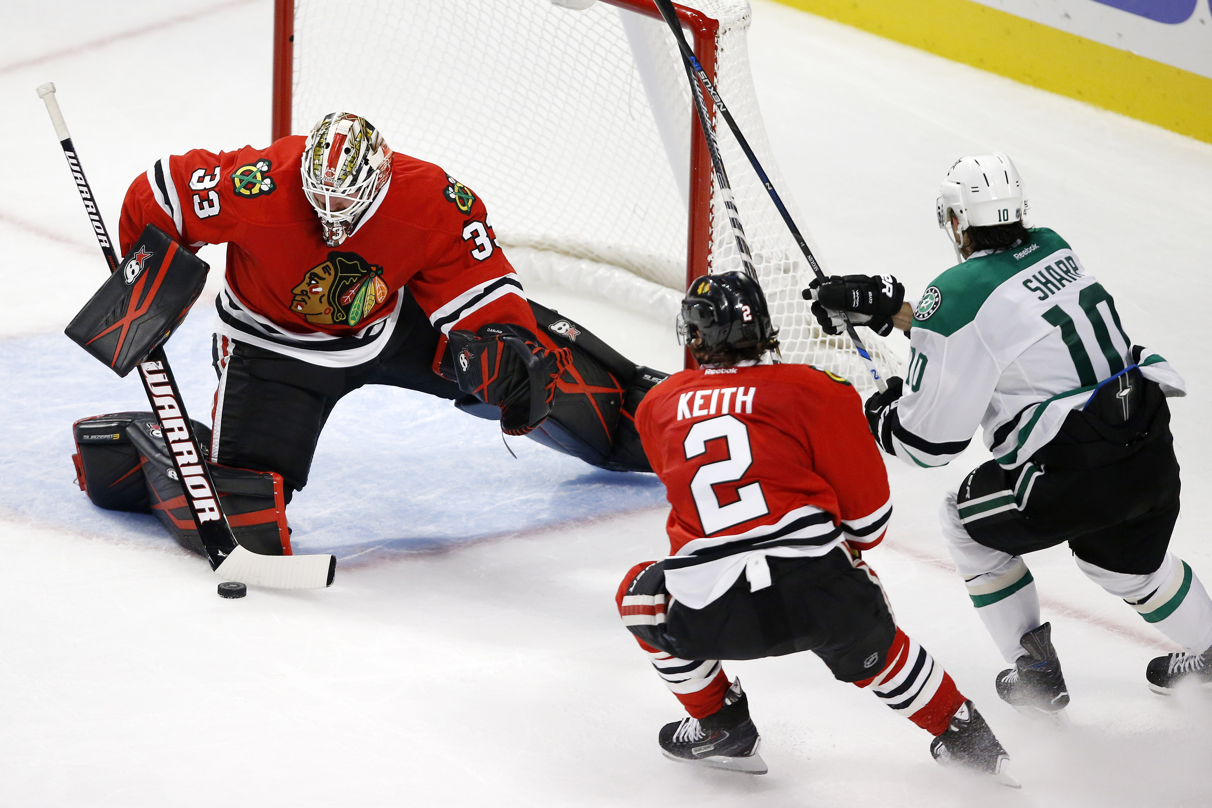 Chicago Blackhawks goalie Scott Darling (33) and defenseman Duncan Keith (2) defend against Dallas Stars right wing Patrick Sharp (10) during the third period of a preseason NHL hockey game Saturday, Oct. 3, 2015, in Chicago. (AP Photo/Andrew A. Nelles)