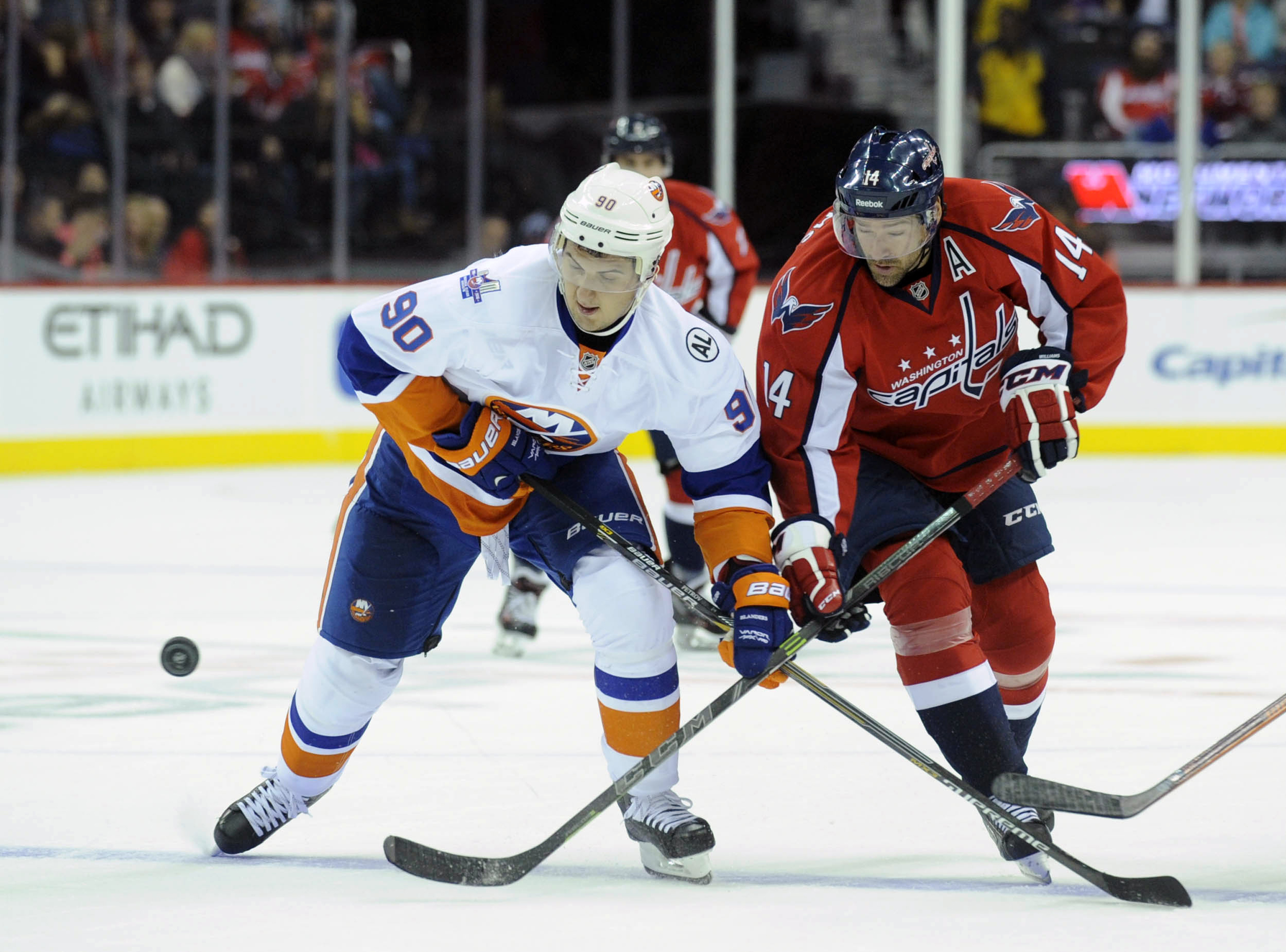FILE - In this Oct. 4, 2015 file photo, New York Islanders' Kirill Petrov (90) and Washington Capitals' Justin Williams (14) look to the puck during the first period of an NHL hockey game in Washington. Alex Ovechkin has heard enough. Enough speculation a