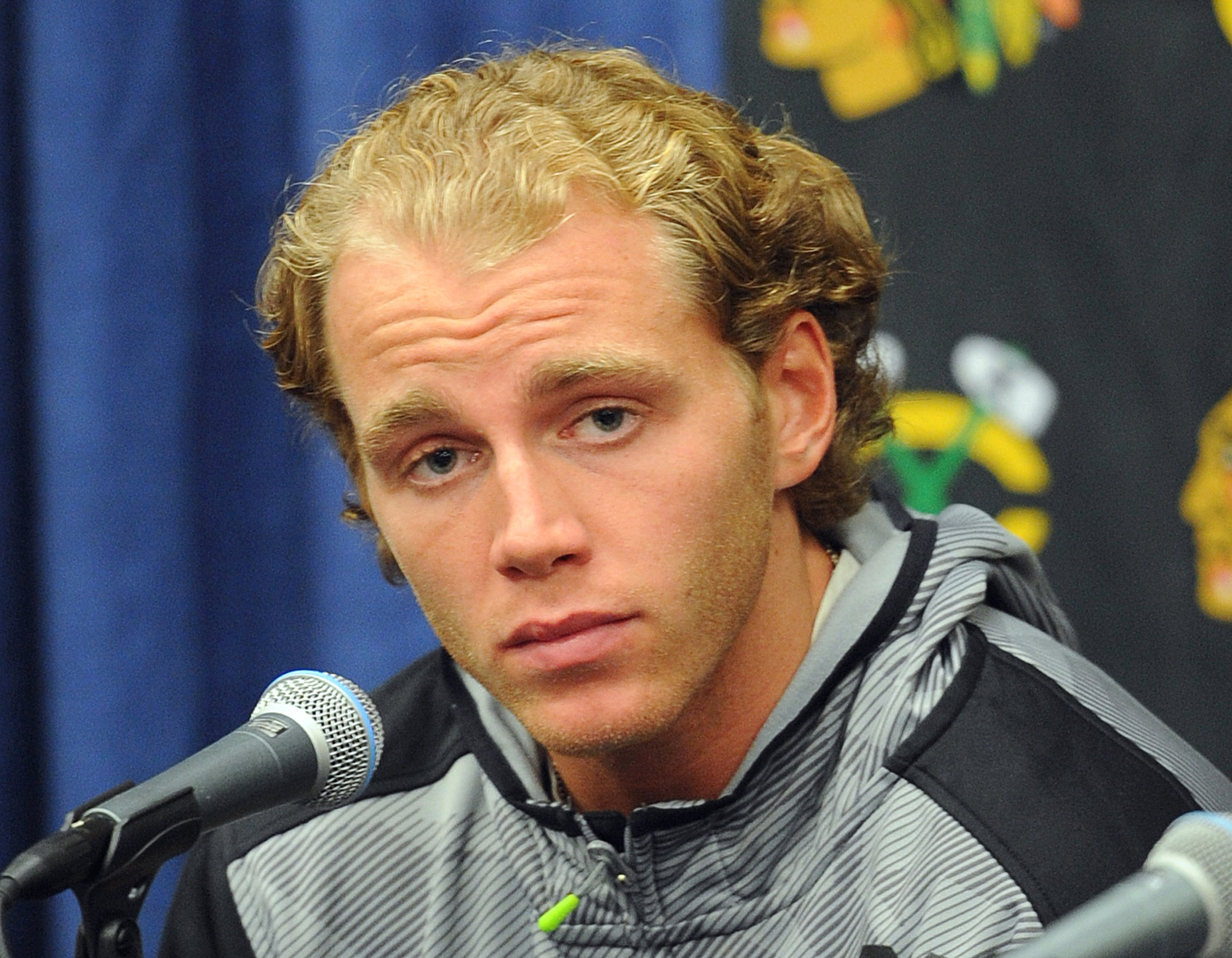 FILE - In this Sept. 17, 2015, file photo, Chicago Blackhawks' Patrick Kane listens during a media availability on the first day of NHL hockey training camp at the Compton Family Ice Center on the campus of the University of Notre Dame in South Bend, Ind.