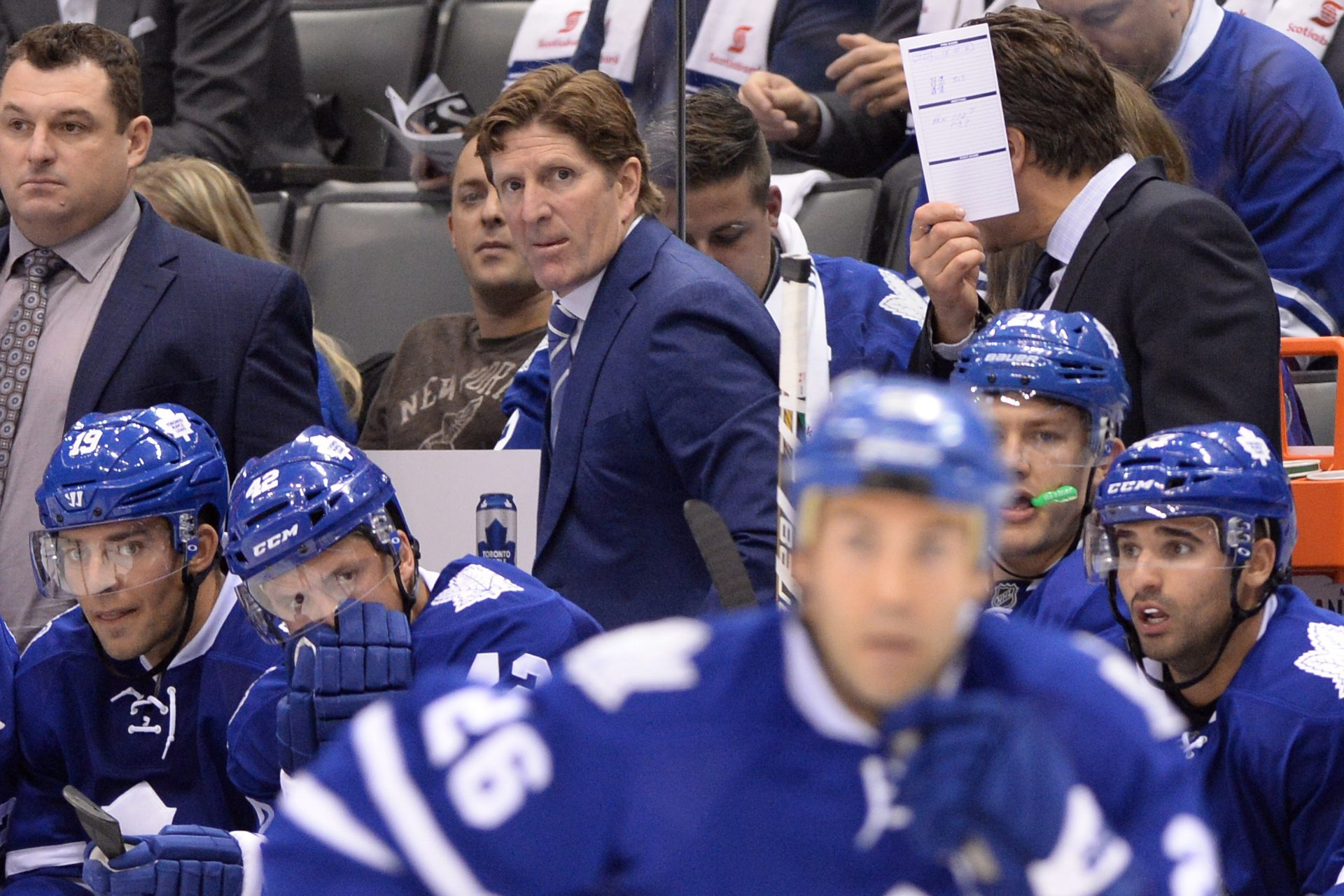 Toronto Maple Leafs head coach Mike Babcock stands behind the bench as his team plays the Montreal Canadiens during the second period of an NHL hockey game, Wednesday, Oct. 7, 2015 in Toronto.  (Frank Gunn/The Canadian Press via AP) MANDATORY CREDIT