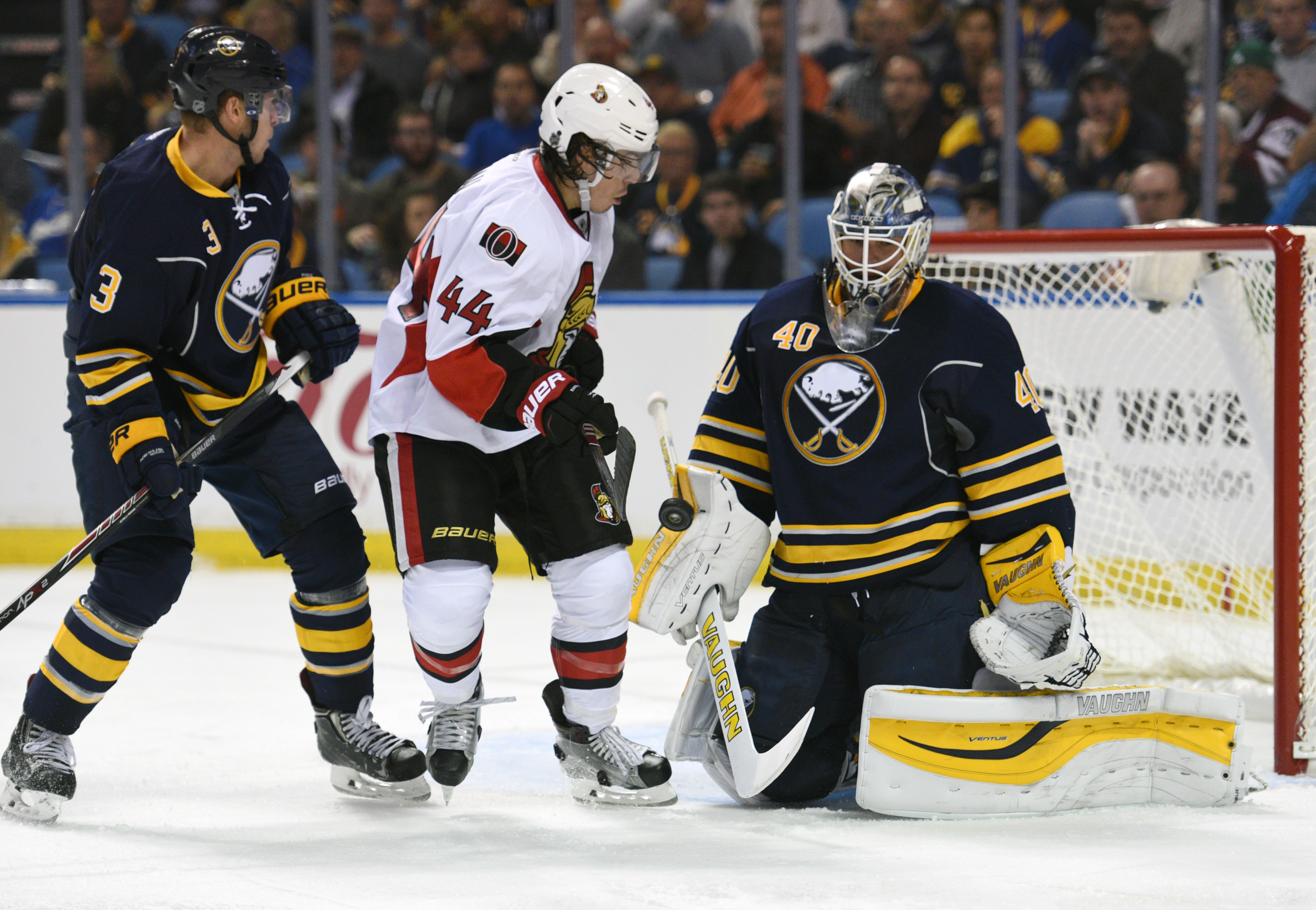 Buffalo Sabres defenseman Mark Pysyk (3) and Ottawa Senators center Jean-Gabriel Pageau (44) watch the blocker save from Sabres goaltender Robin Lehner (40) during the second period of an NHL hockey game, Thursday, Oct. 8, 2015, in Buffalo, N.Y. (AP Photo