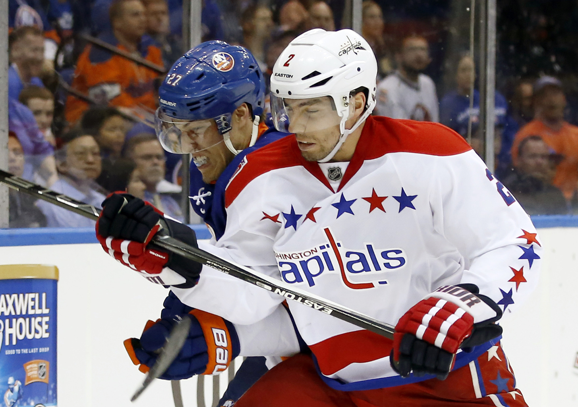 FILE - In this April 21, 2015, file photo, Washington Capitals defenseman Matt Niskanen (2) checks New York Islanders center Anders Lee (27) during Game 4 of a first-round NHL Stanley Cup hockey playoff series in Uniondale, N.Y. Count Niskanen among those