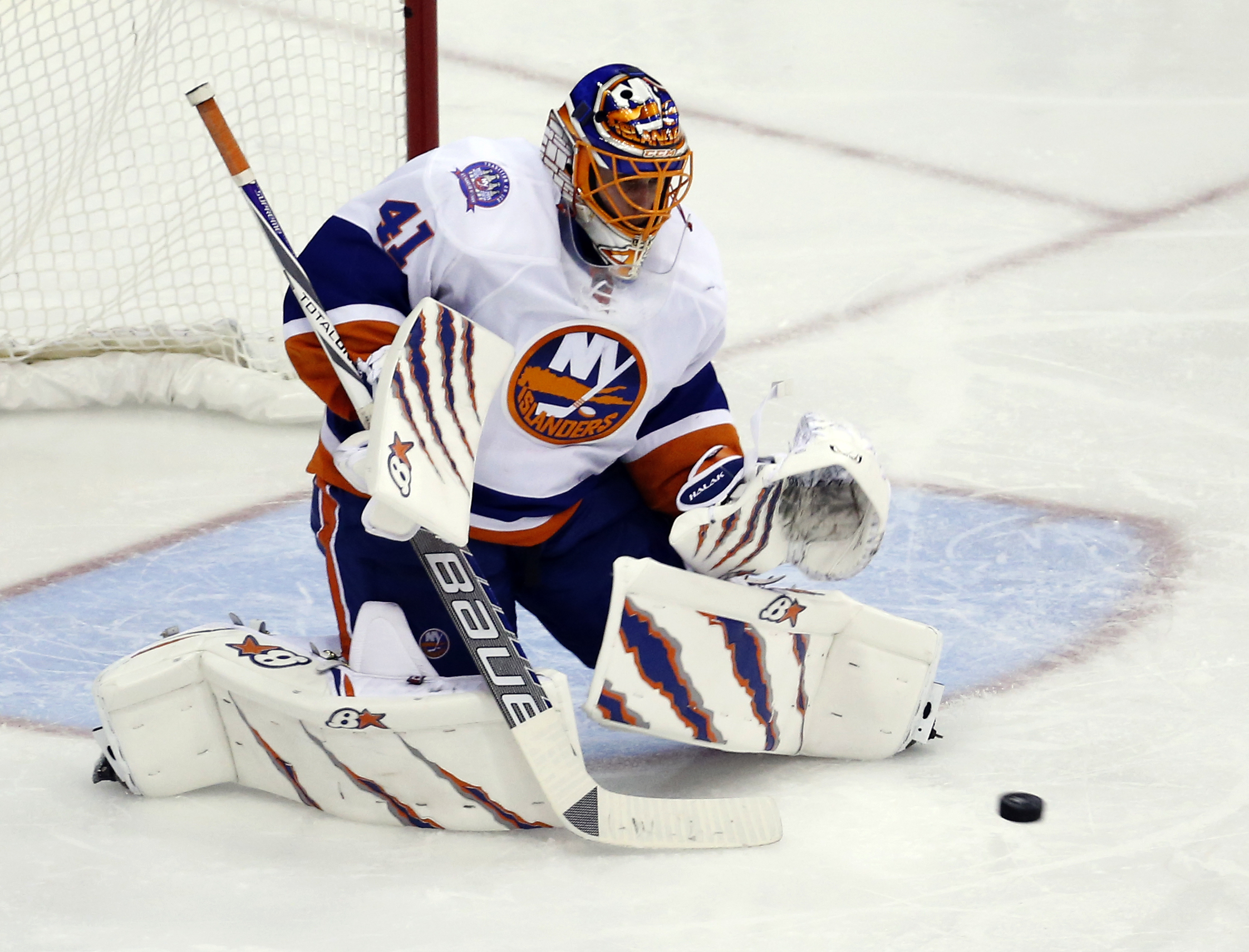New York Islanders goalie Jaroslav Halak (41), from Slovakia, prepares to catch a shot during the third period of Game 2 in the first round of the NHL hockey Stanley Cup playoffs against the Washington Capitals, Friday, April 17, 2015, in Washington. The