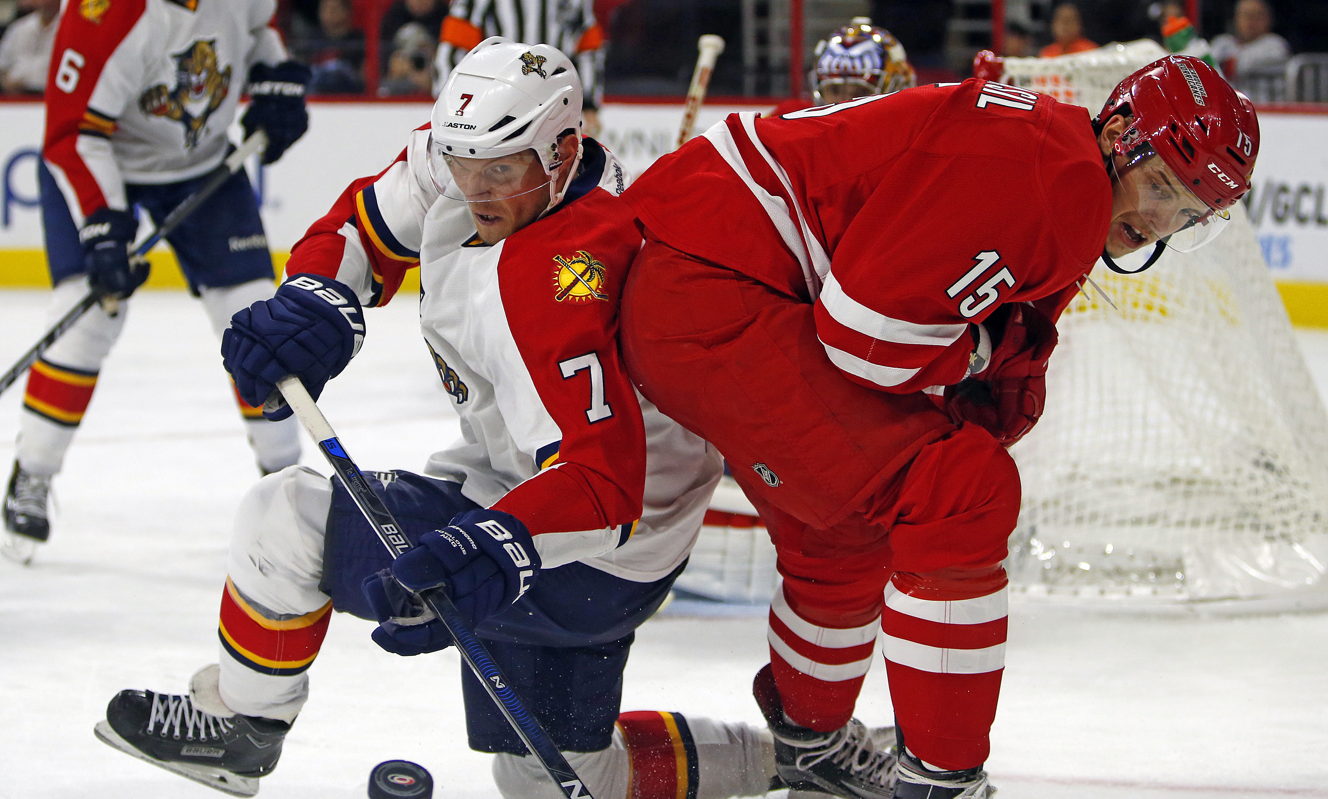 Florida Panthers' Dmitry Kulikov (7) of Russia, battles Carolina Hurricanes' Andrej Nestrasil (15) of Czech Republic for the puck, during the second period of an NHL hockey game, Tuesday, Oct. 13, 2015, in Raleigh, N.C. (AP Photo/Karl B DeBlaker)