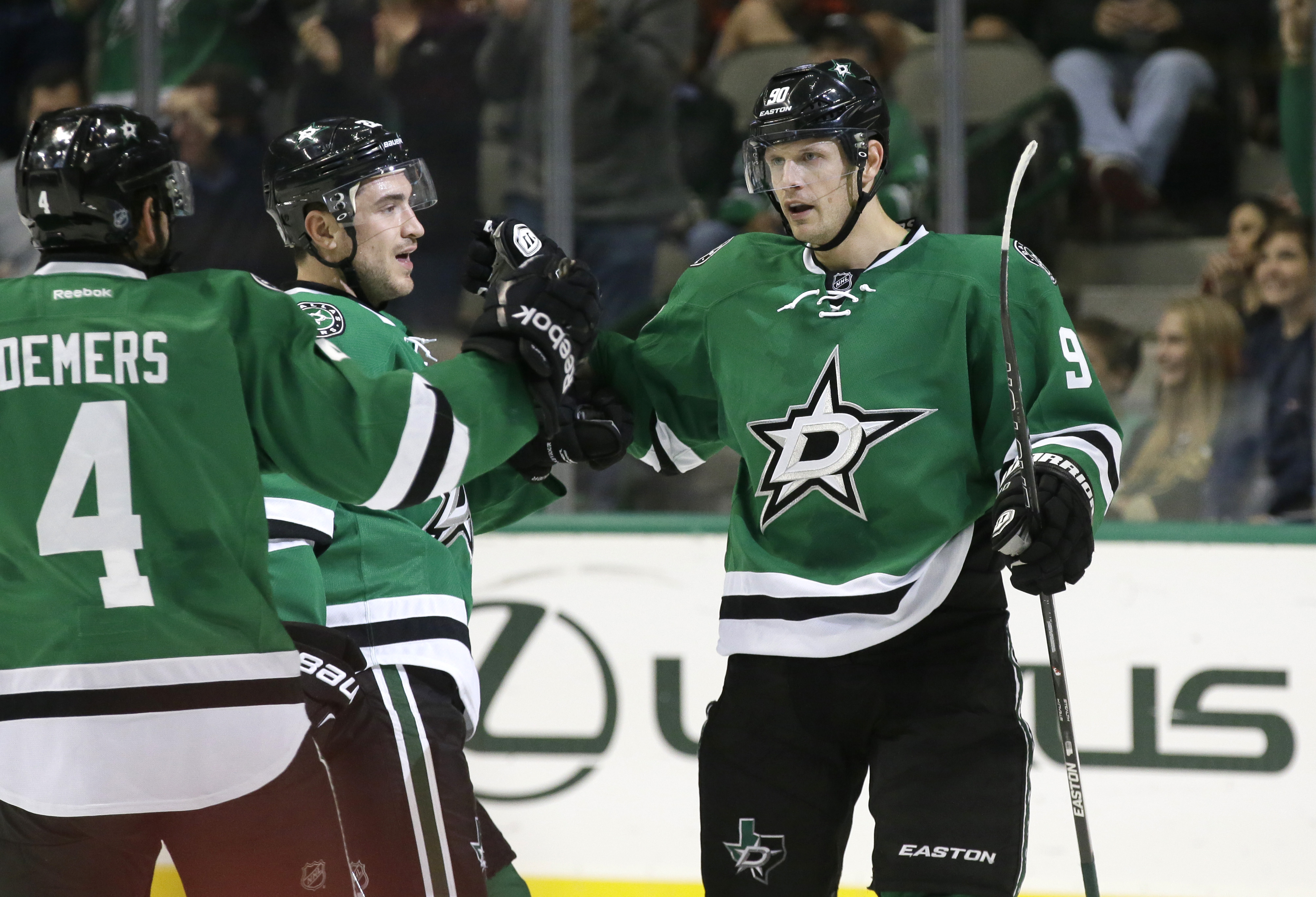 Dallas Stars center Jason Spezza (90) celebrates his goal with teammates Jason Demers (4) and Colton Sceviour during the first period of an NHL hockey game  against the Edmonton Oilers Tuesday, Oct. 13, 2015, in Dallas. (AP Photo/LM Otero)