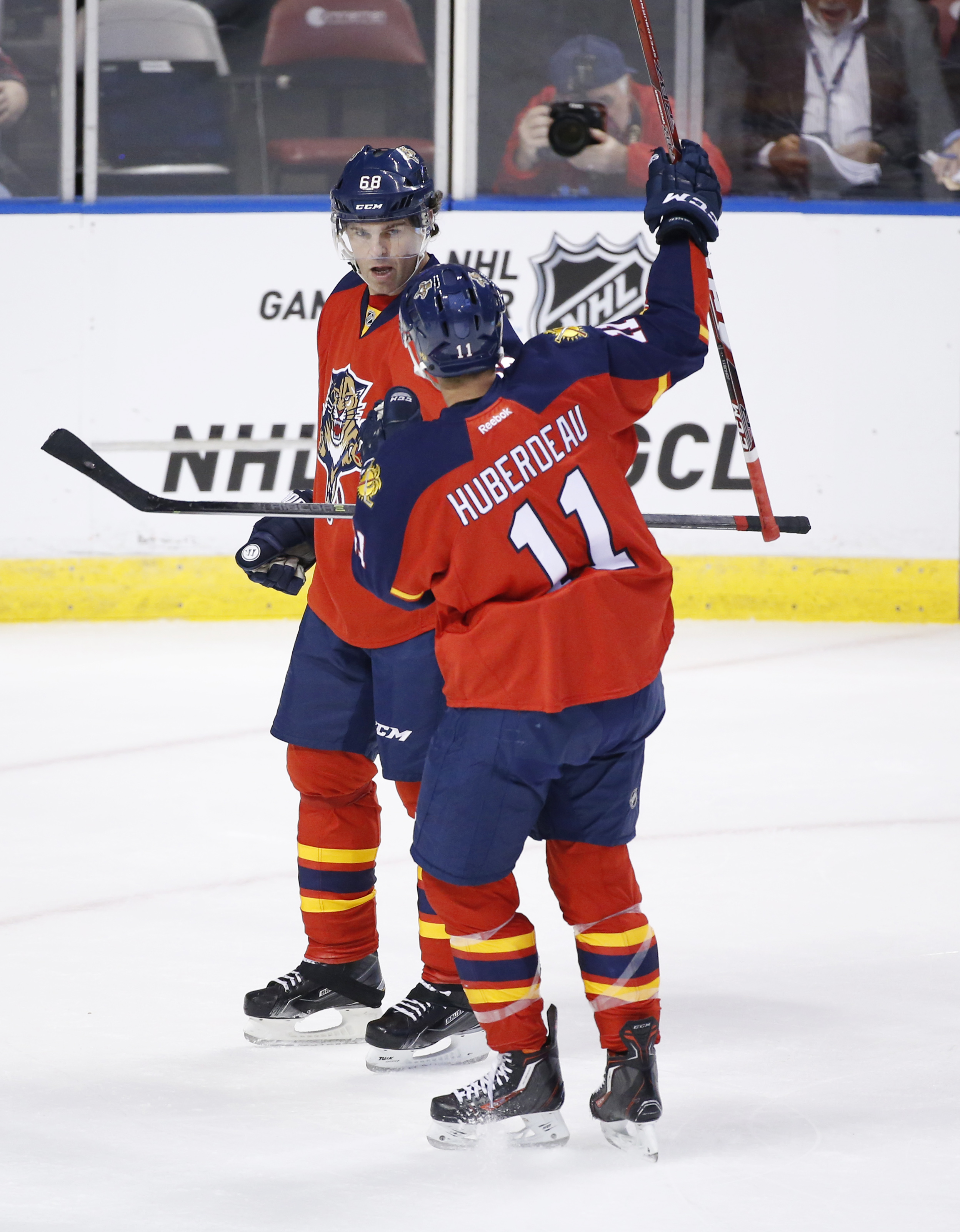 Florida Panthers right wing Jaromir Jagr (68) celebrates with center Jonathan Huberdeau (11) after Jagr scored a goal during the first period of an NHL hockey game against the Buffalo Sabres, Thursday, Oct. 15, 2015 in Sunrise, Fla. (AP Photo/Wilfredo Lee