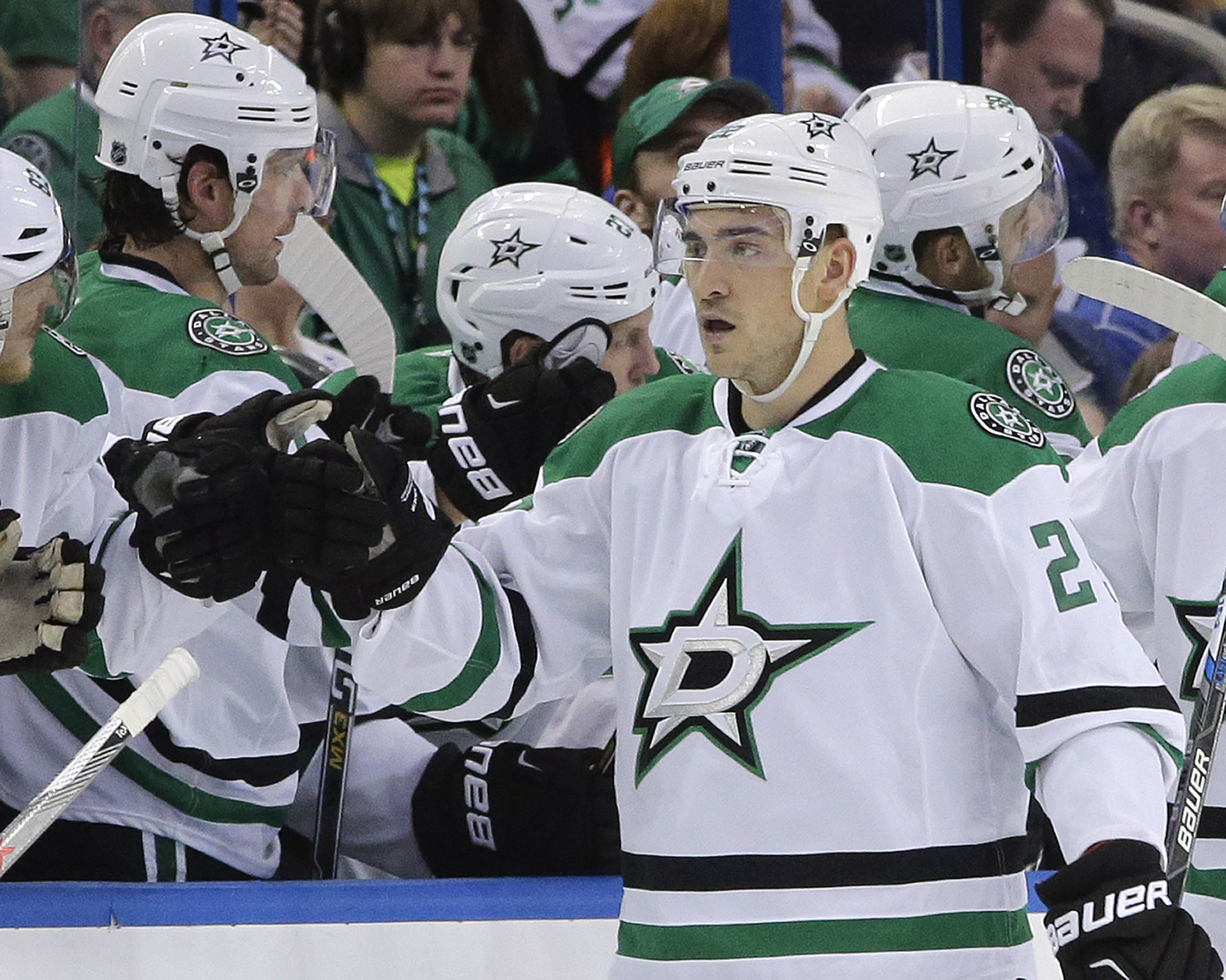 Dallas Stars center Cody Eakin (20) celebrates with the bench after scoring against the Tampa Bay Lightning during the second period of an NHL hockey game Thursday, Oct. 15, 2015, in Tampa, Fla. (AP Photo/Chris O'Meara)