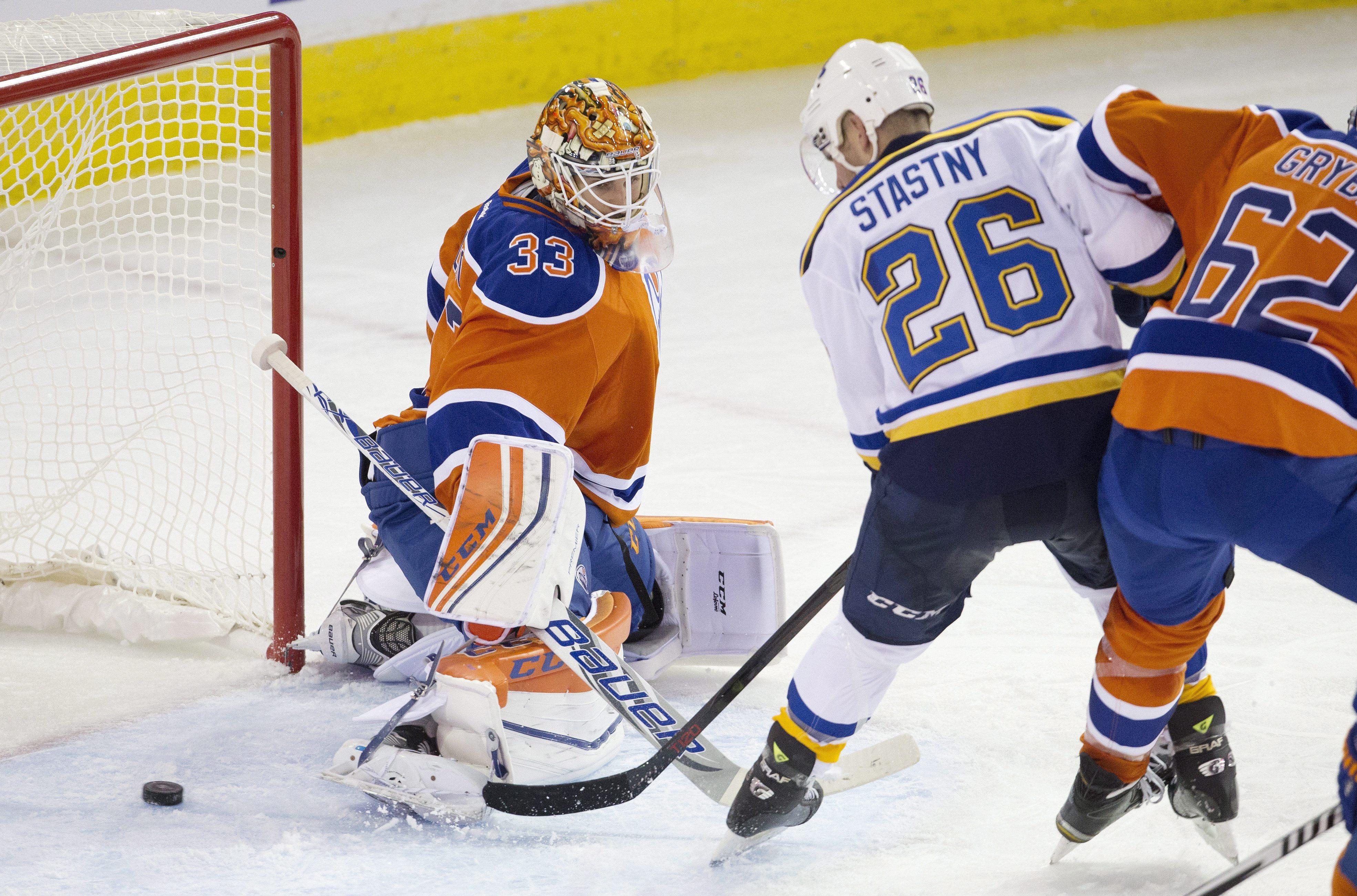 St. Louis Blues' Paul Stastny (26) scores a goal on Edmonton Oilers goalie Cam Talbot (33) during the third period of an NHL hockey game Thursday, Oct. 15, 2015, in Edmonton, Alberta. (Jason Franson/The Canadian Press via AP)