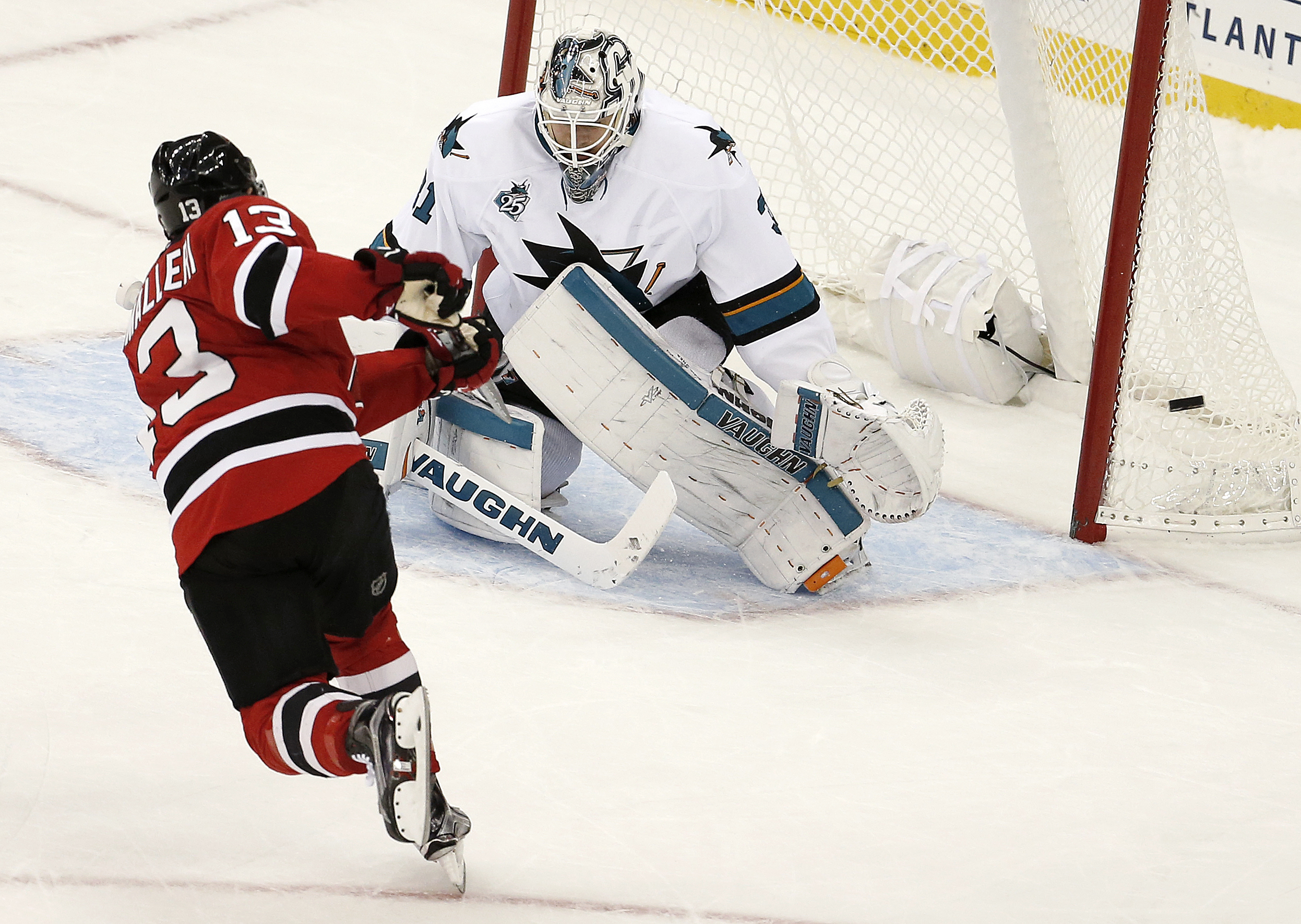 New Jersey Devils left wing Mike Cammalleri (13) misses a shootout shot against San Jose Sharks goalie Martin Jones (31) during an NHL hockey game, Friday, Oct. 16, 2015, in Newark, N.J. The Sharks won 2-1 in a shootout. (AP Photo/Julio Cortez)