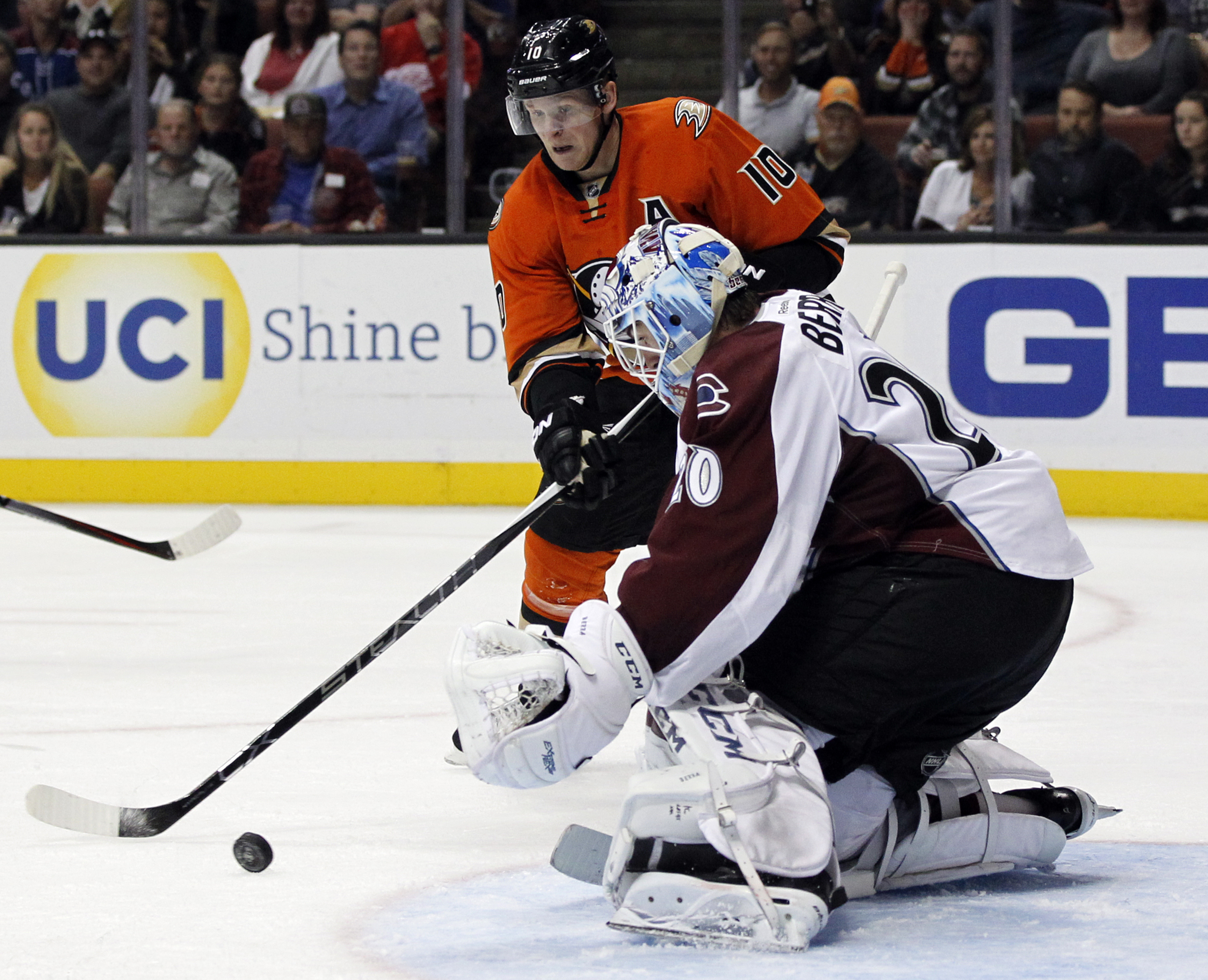Anaheim Ducks right wing Corey Perry (10) battles Colorado Avalanche goalie Reto Berra (20), of Switzerland for the puck during the second period of an NHL hockey game in Anaheim, Calif., Friday, Oct. 16, 2015. (AP Photo/Alex Gallardo)