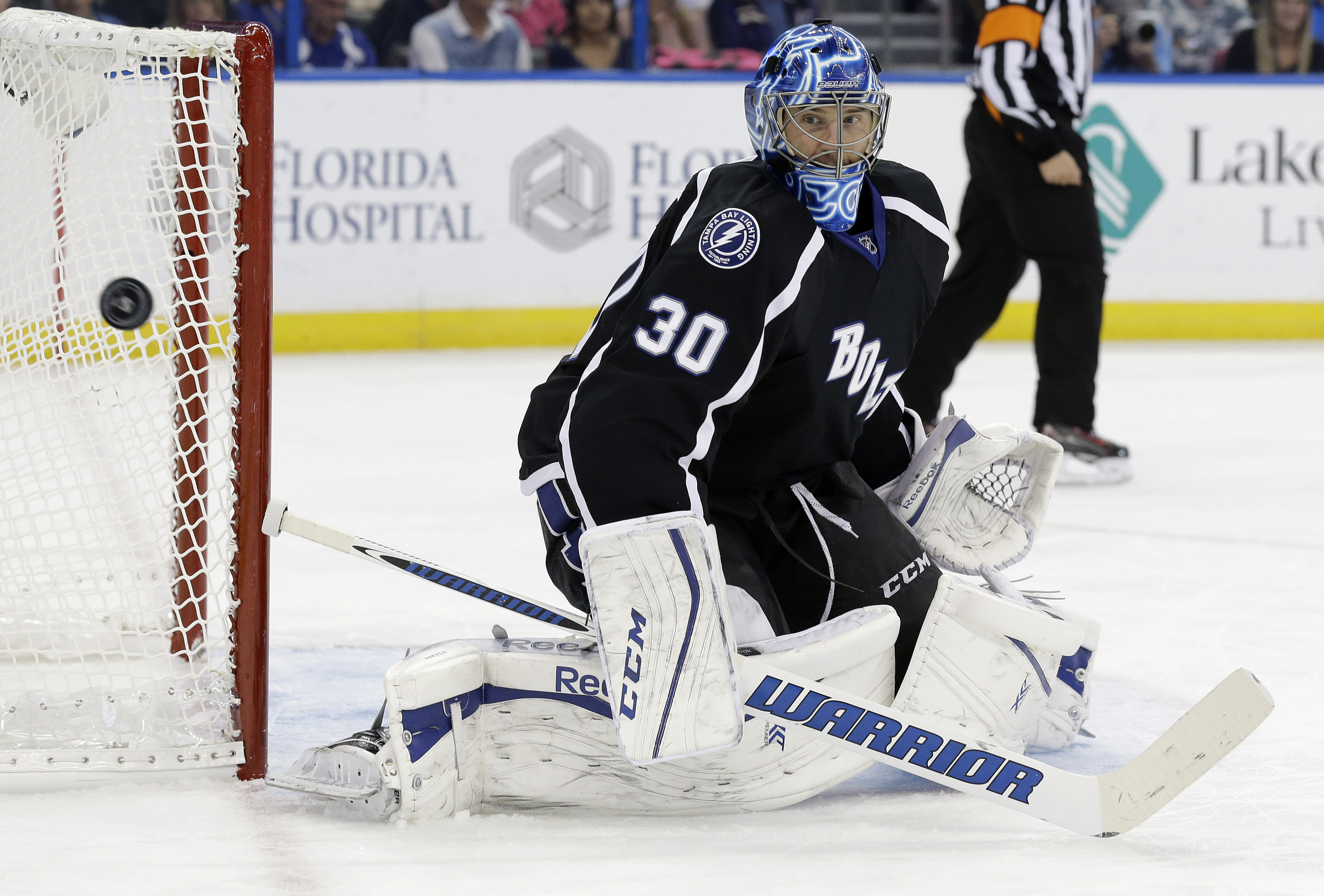 Tampa Bay Lightning goalie Ben Bishop (30) makes a save on a shot by the Buffalo Sabres during the first period of an NHL hockey game Saturday, Oct. 17, 2015, in Tampa, Fla. (AP Photo/Chris O'Meara)