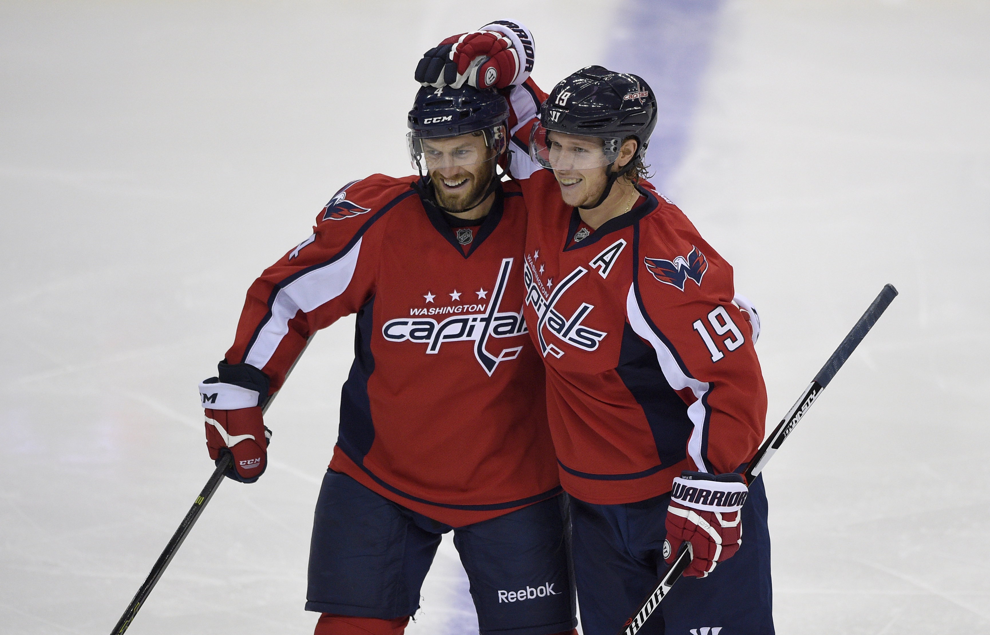 Washington Capitals center Nicklas Backstrom (19), of Sweden, celebrates his goal with Taylor Chorney (4) during the third period of an NHL hockey game against the Carolina Hurricanes, Saturday, Oct. 17, 2015, in Washington. The Capitals won 4-1. (AP Phot