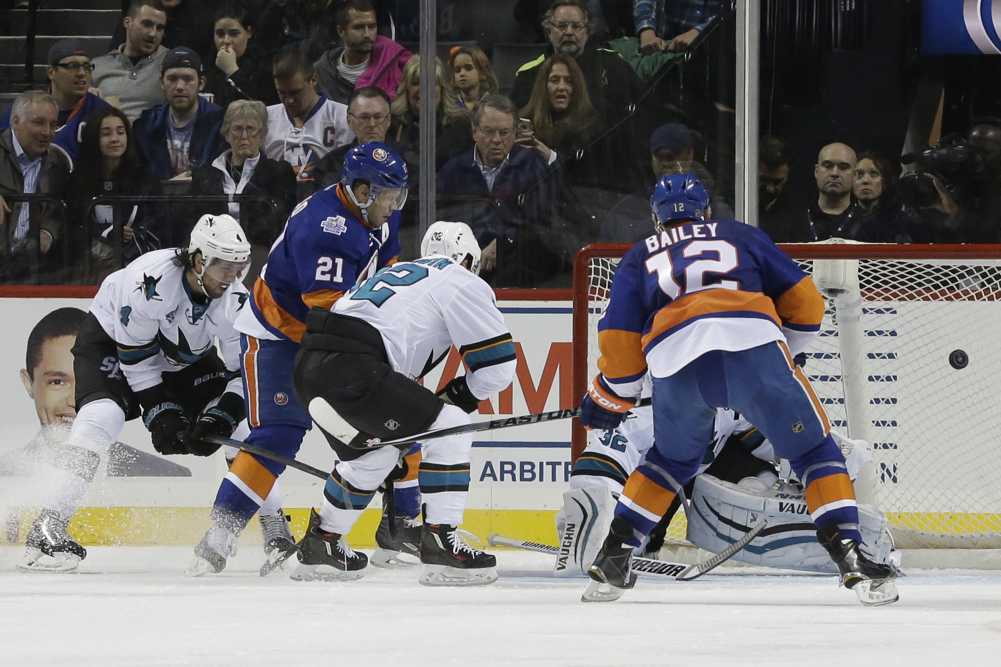 New York Islanders right wing Kyle Okposo (21) scores a goal during the third period of an NHL hockey game against the San Jose Sharks, Saturday, Oct. 17, 2015 in New York. The Islanders won 6-3. (AP Photo/Mary Altaffer)