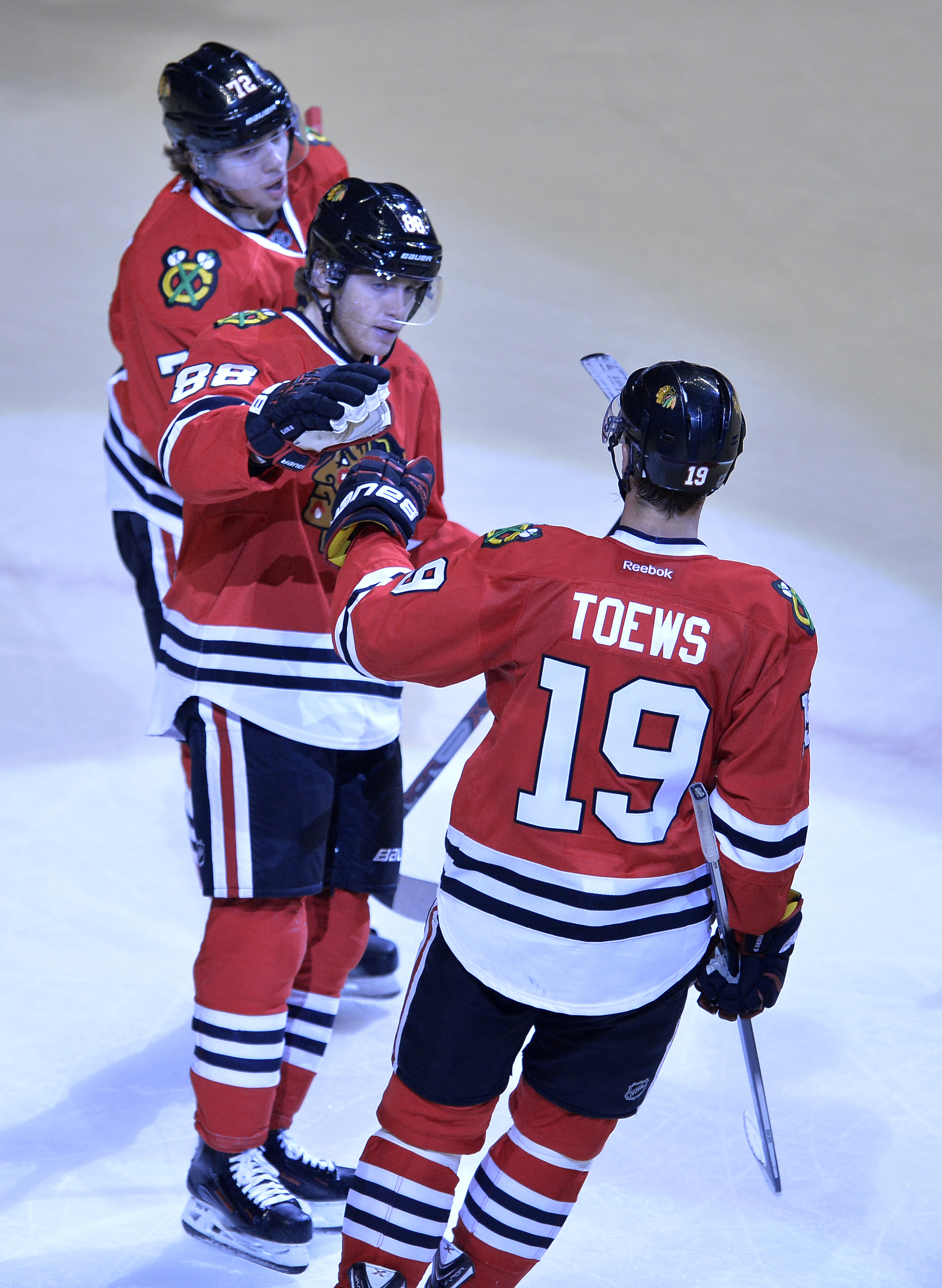 Chicago Blackhawks' Patrick Kane (88), celebrates with teammate Jonathan Toews (19), while Artemi Panarin (72), of Russia, looks on after Kane scored a goal during the third period of an NHL hockey game against the Columbus Blue Jackets Saturday, Oct. 17,