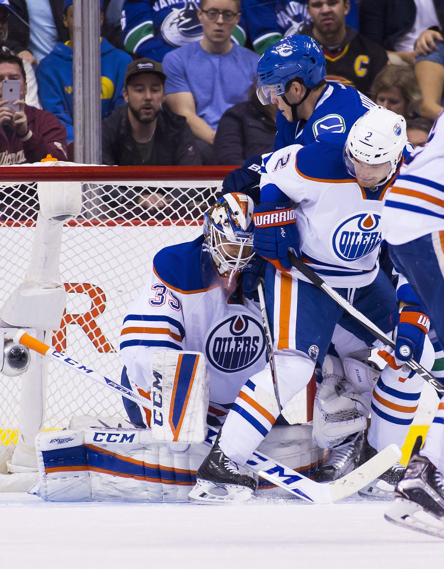 Edmonton Oilers goaltender Anders Nilsson (39) allows a goal by Matt Bartkowski near Vancouver Canucks' Bo Horvat (53) and Edmonton Oilers' Andrej Sekera (2) during the first period of an NHL hockey game Sunday, Oct. 18, 2015, in Vancouver, British Columb