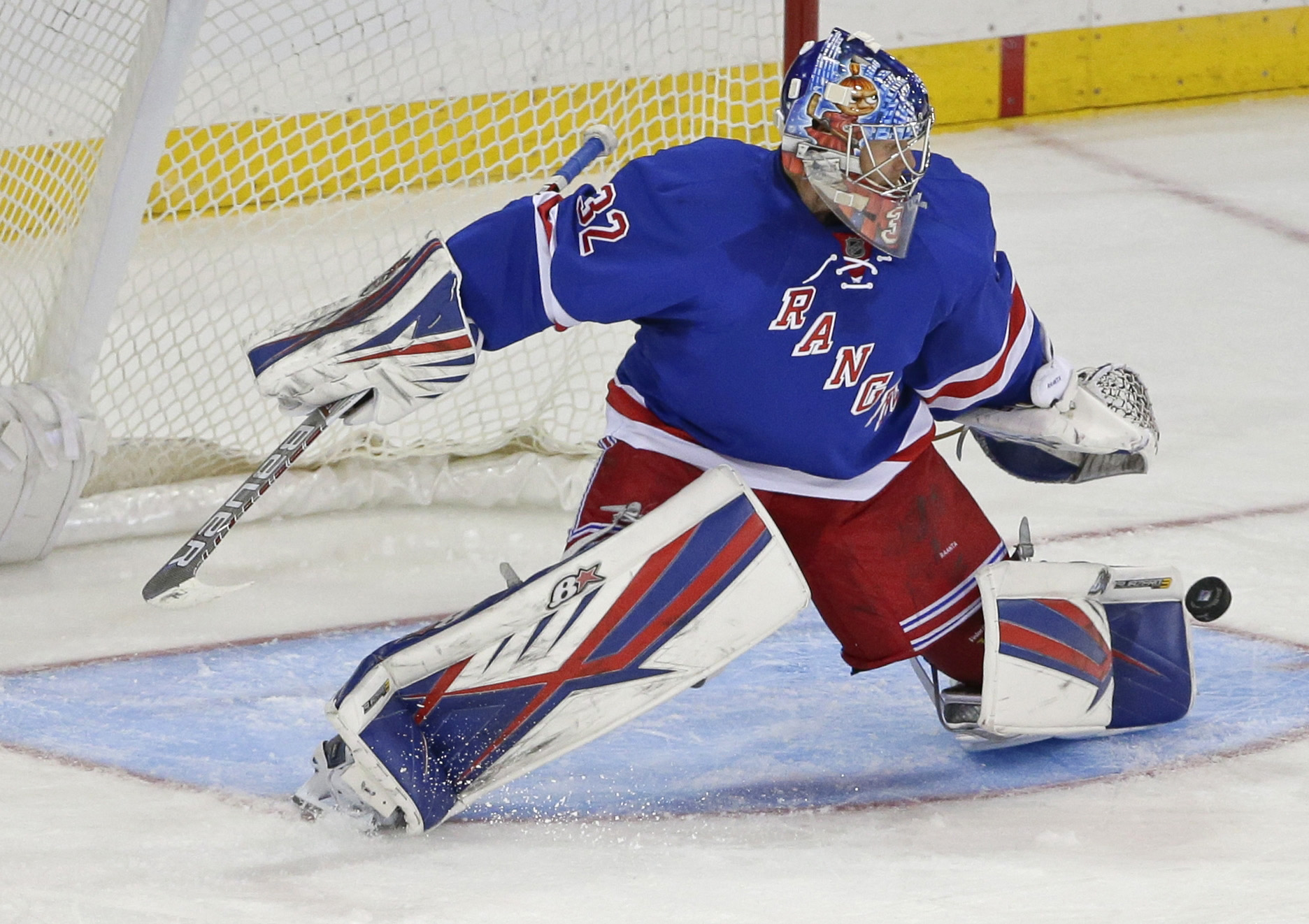New York Rangers goalie Antti Raanta (32) stops a shot on the goal during the third period of an NHL hockey game against the San Jose Sharks Monday, Oct. 19, 2015, in New York. The Rangers won 4-0. (AP Photo/Frank Franklin II)