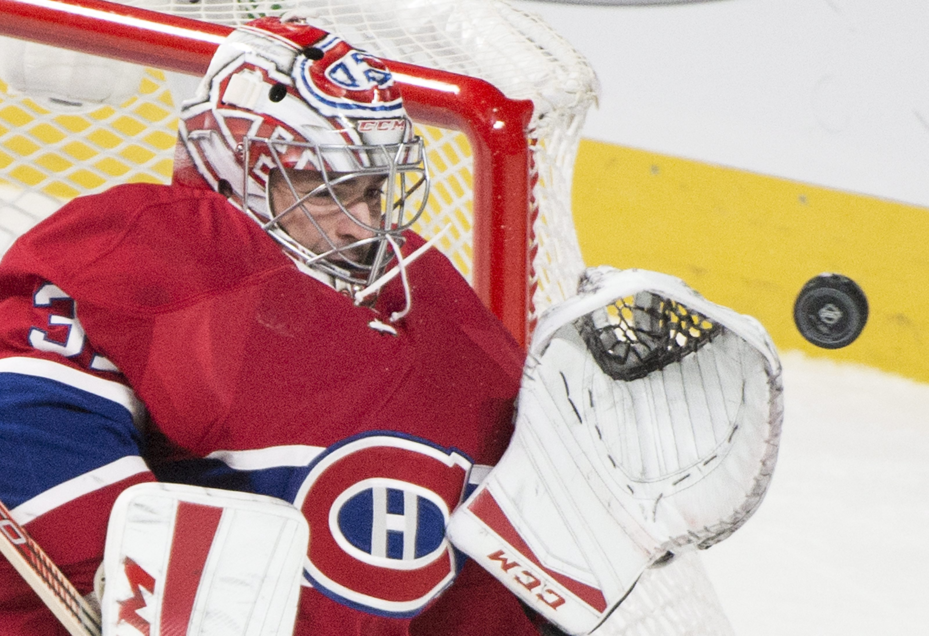 Montreal Canadiens goaltender Carey Price makes a save against the St. Louis Blues during the third period of an NHL hockey game, Tuesday, Oct. 20, 2015 in Montreal. (Graham Hughes/The Canadian Press via AP) MANDATORY CREDIT
