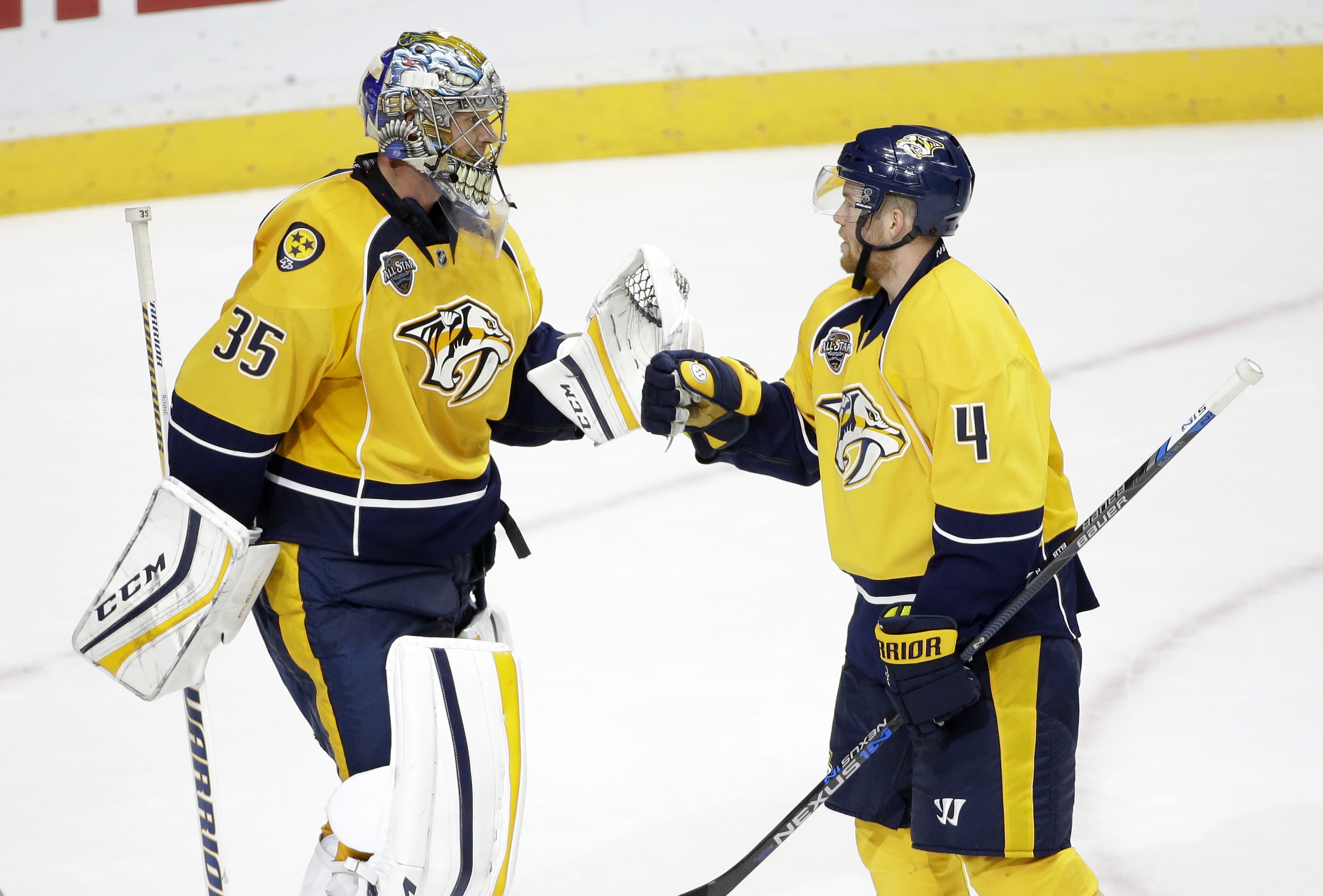 Nashville Predators defenseman Ryan Ellis (4) congratulates goalie Pekka Rinne (35), of Finland, after defeating the Anaheim Ducks 5-1 in an NHL hockey game Thursday, Oct. 22, 2015, in Nashville, Tenn. (AP Photo/Mark Humphrey)