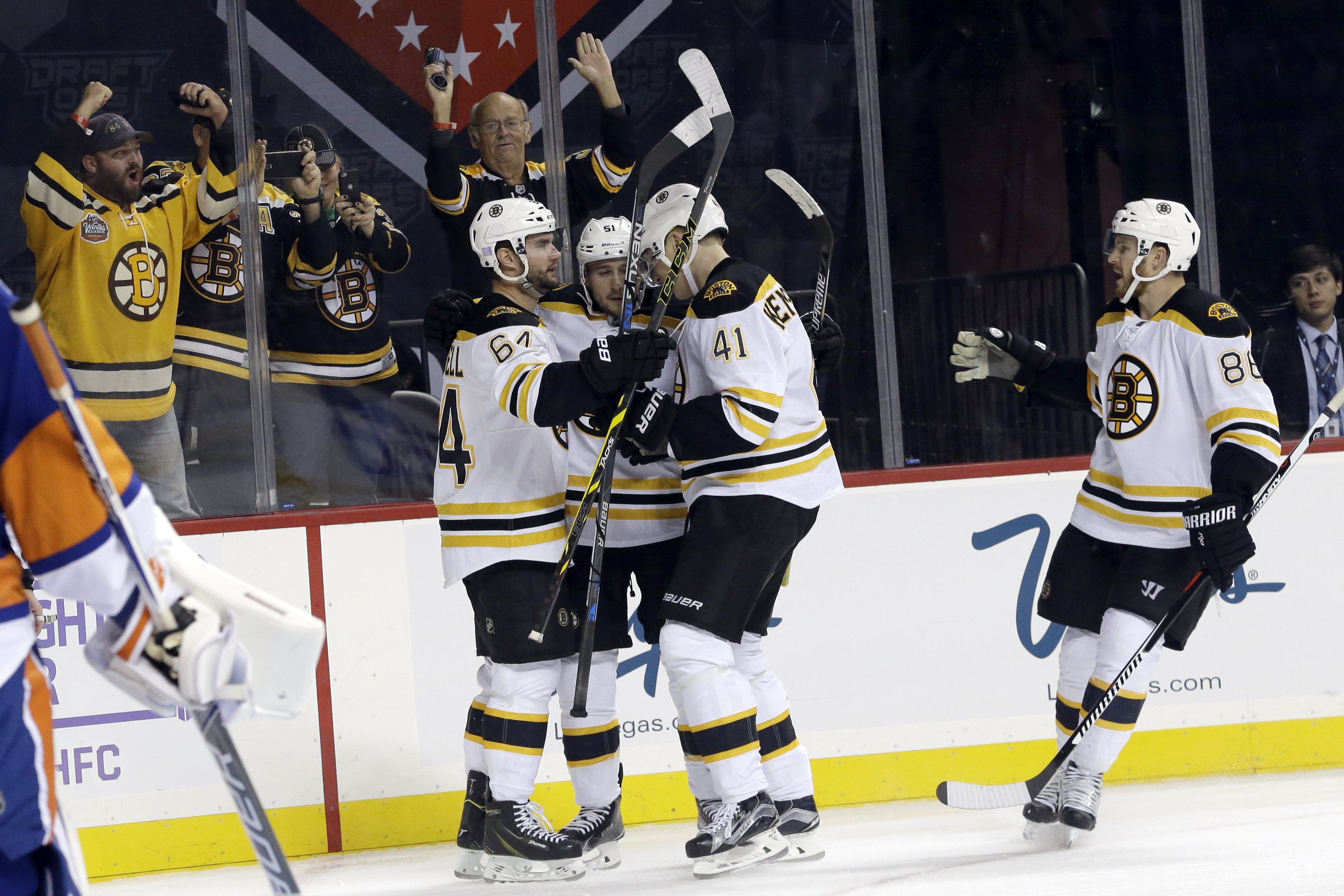 Boston Bruins center Ryan Spooner (51) celebrates with teammates after scoring during the third period of an NHL hockey game against the New York Islanders, Friday, Oct. 23, 2015, in New York. The Bruins won 5-3. (AP Photo/Mary Altaffer)