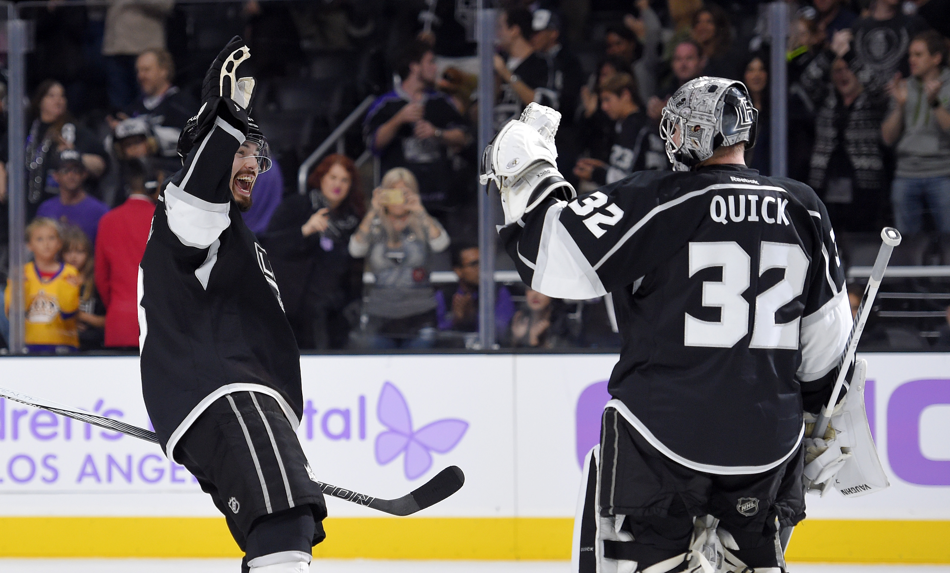 Los Angeles Kings defenseman Drew Doughty, left, congratulates goalie Jonathan Quick after the Kings defeated the Carolina Hurricanes 3-0 in a NHL hockey game, Friday, Oct. 23, 2015, in Los Angeles. (AP Photo/Mark J. Terrill)