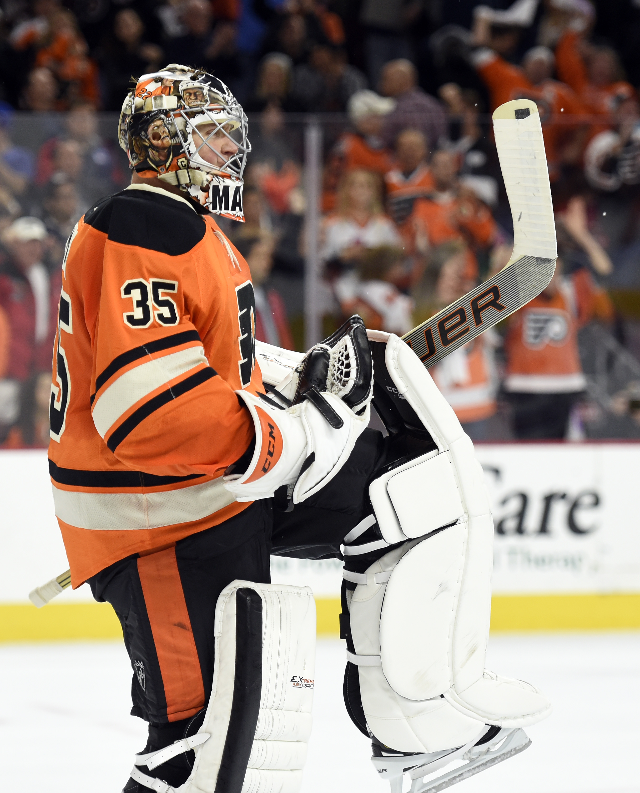 Philadelphia Flyers goalie Steve Mason (35) celebrates after he blocks a shot from New York Rangers' Dominic Moore during a shoot out in an NHL hockey game, Saturday, Oct. 24, 2015, in Philadelphia. The Flyers won 3-2. (AP Photo/Michael Perez)