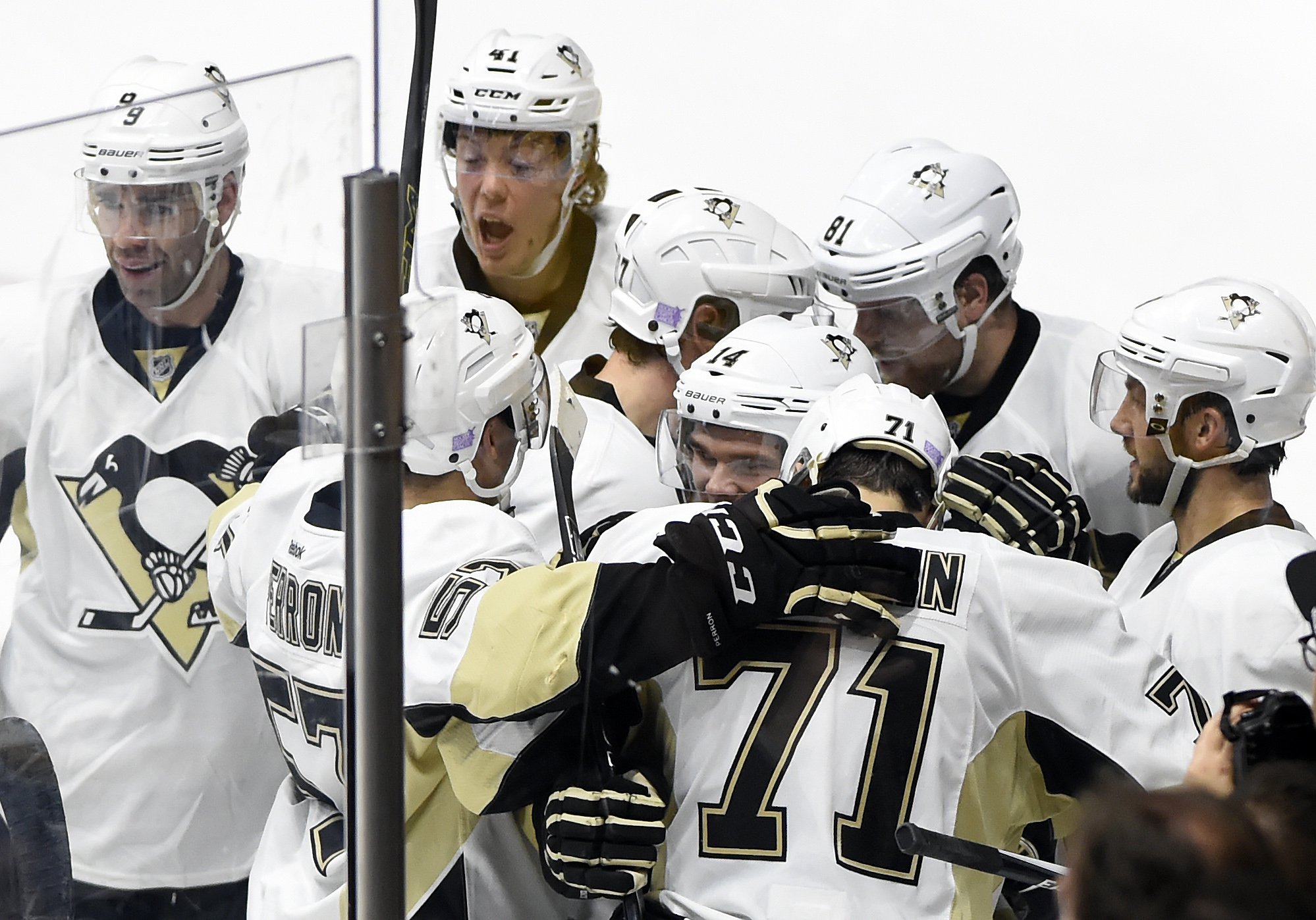 Pittsburgh Penguins right wing Phil Kessel (81) celebrates with teammates after scoring a goal in overtime of an NHL hockey game against the Nashville Predators, Saturday, Oct. 24, 2015, in Nashville, Tenn. The Penguins won 2-1. (AP Photo/Mark Zaleski)