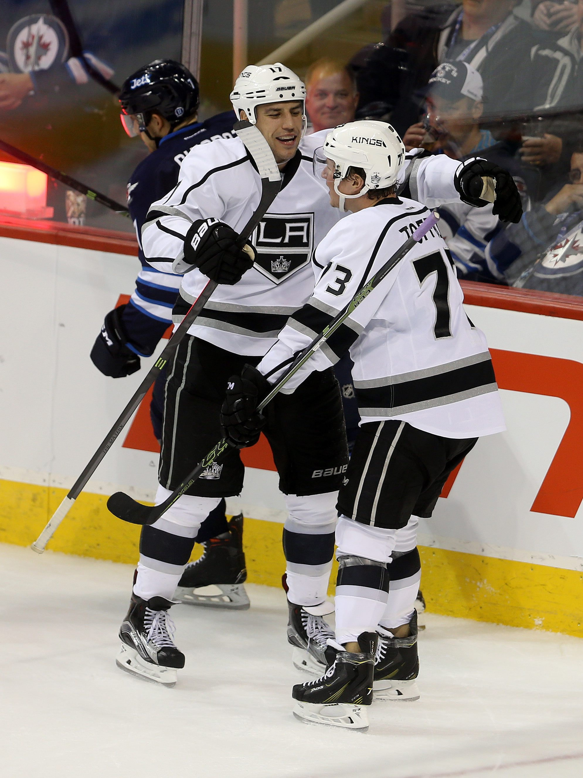 Los Angeles Kings' Milan Lucic (17) celebrates with teammate Tyler Toffoli (73), right, after Lucic scored on the Winnipeg Jets' during the third period of an NHL hockey game in Winnipeg, Manitoba Tuesday, Oct. 27, 2015. The Kings defeated Jets 4-1. (Trev