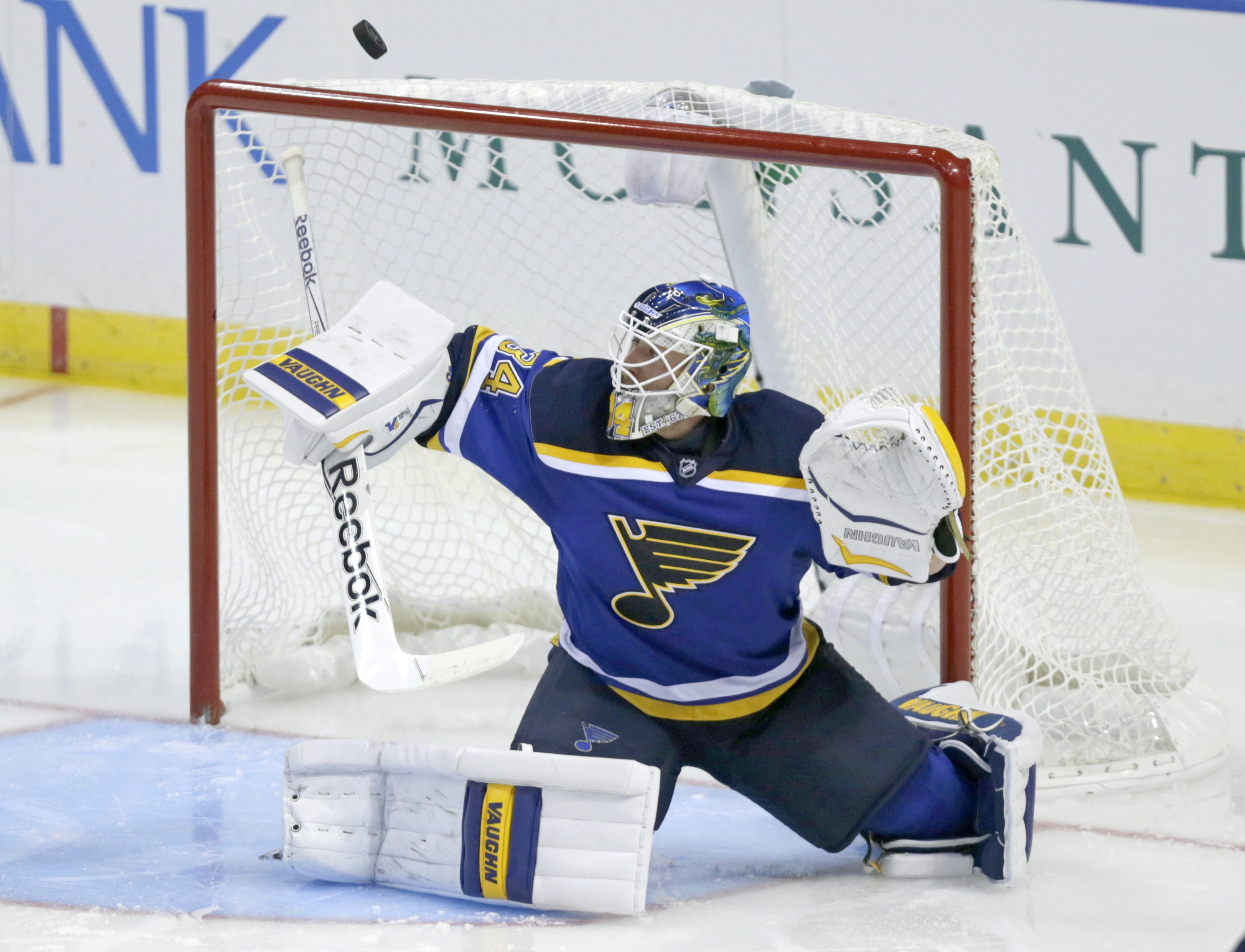 St. Louis Blues goalie Jake Allen (34) makes a stick save in the third period of an NHL hockey game against the Tampa Bay Lightning, Tuesday, Oct. 27, 2015 in St. Louis. Allen stopped all 26 shots he faced as the Blues beat the Lightning 2-0. (AP Photo/To