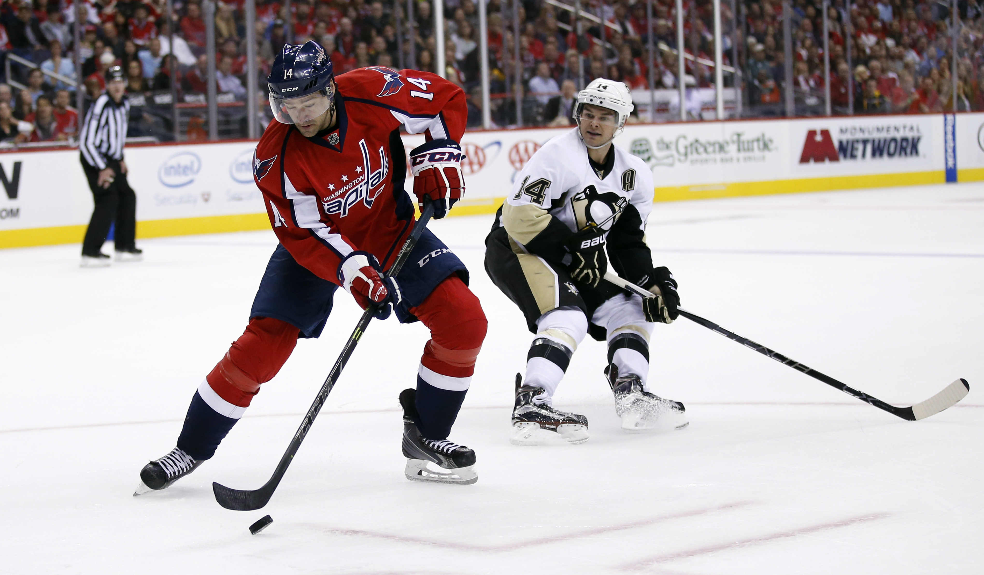 Washington Capitals right wing Justin Williams (14) skates with the puck as Pittsburgh Penguins left wing Chris Kunitz (14) defends in the second period of an NHL hockey game, Wednesday, Oct. 28, 2015, in Washington. (AP Photo/Alex Brandon)