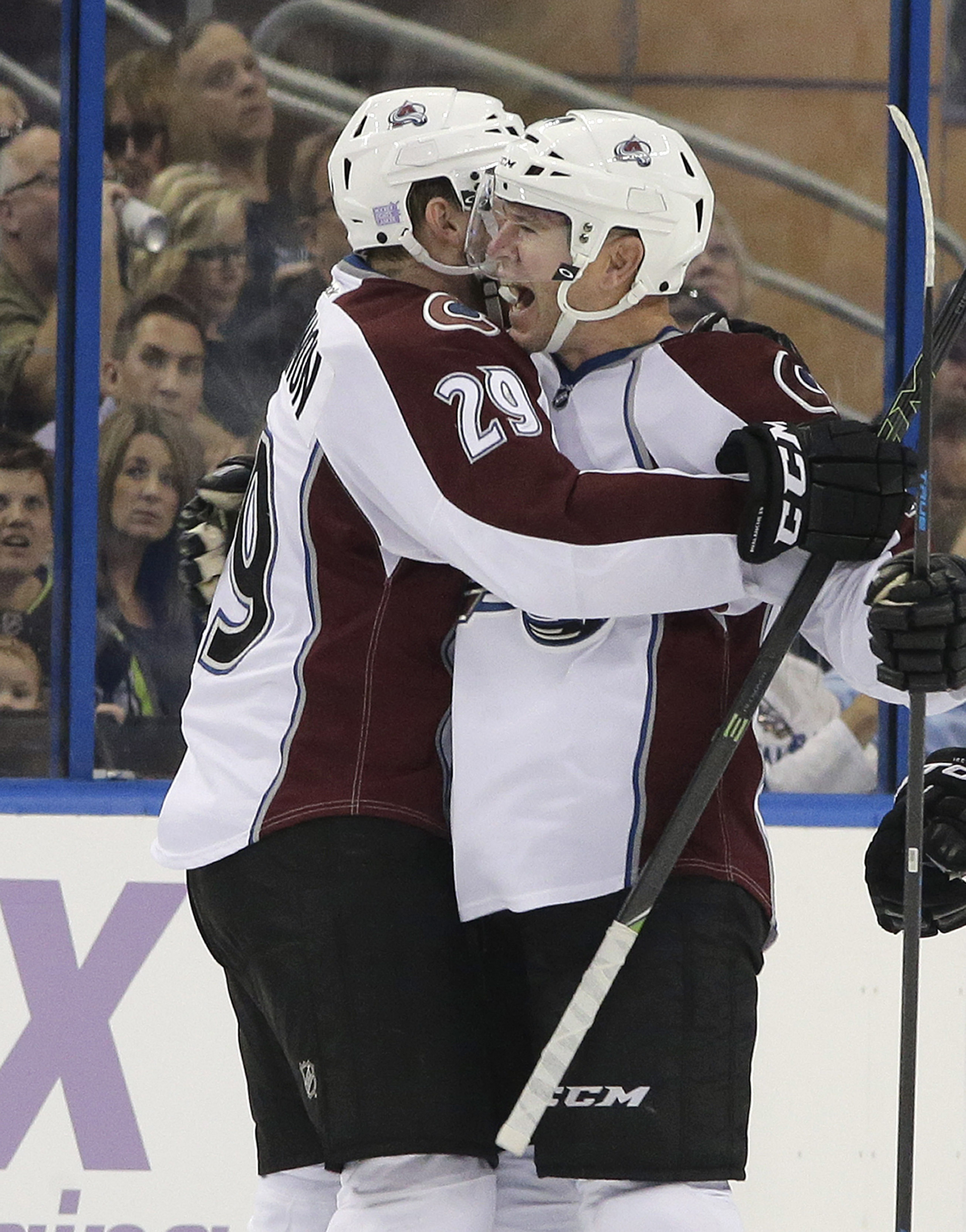 Colorado Avalanche left wing Alex Tanguay, right, celebrates with teammate center Nathan MacKinnon after scoring against the Tampa Bay Lightning during the first period of an NHL hockey game Thursday, Oct. 29, 2015, in Tampa, Fla. (AP Photo/Chris O'Meara)