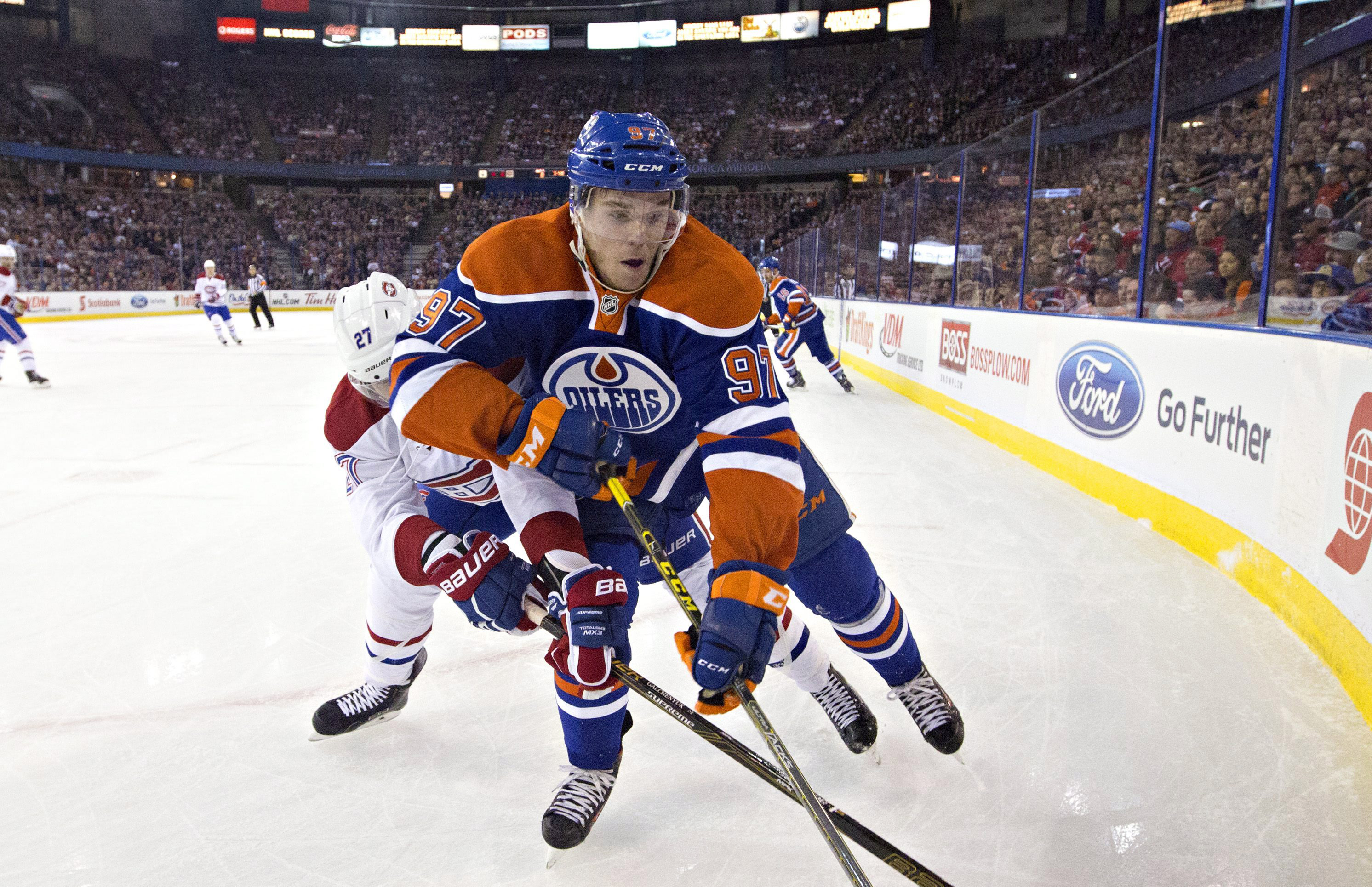 Montreal Canadiens' Alex Galchenyuk (27) and Edmonton Oilers' Connor McDavid (97) compete during first-period NHL hockey game action in Edmonton, Alberta, Thursday, Oct. 29, 2015. (Jason Franson/The Canadian Press via AP) MANDATORY CREDIT