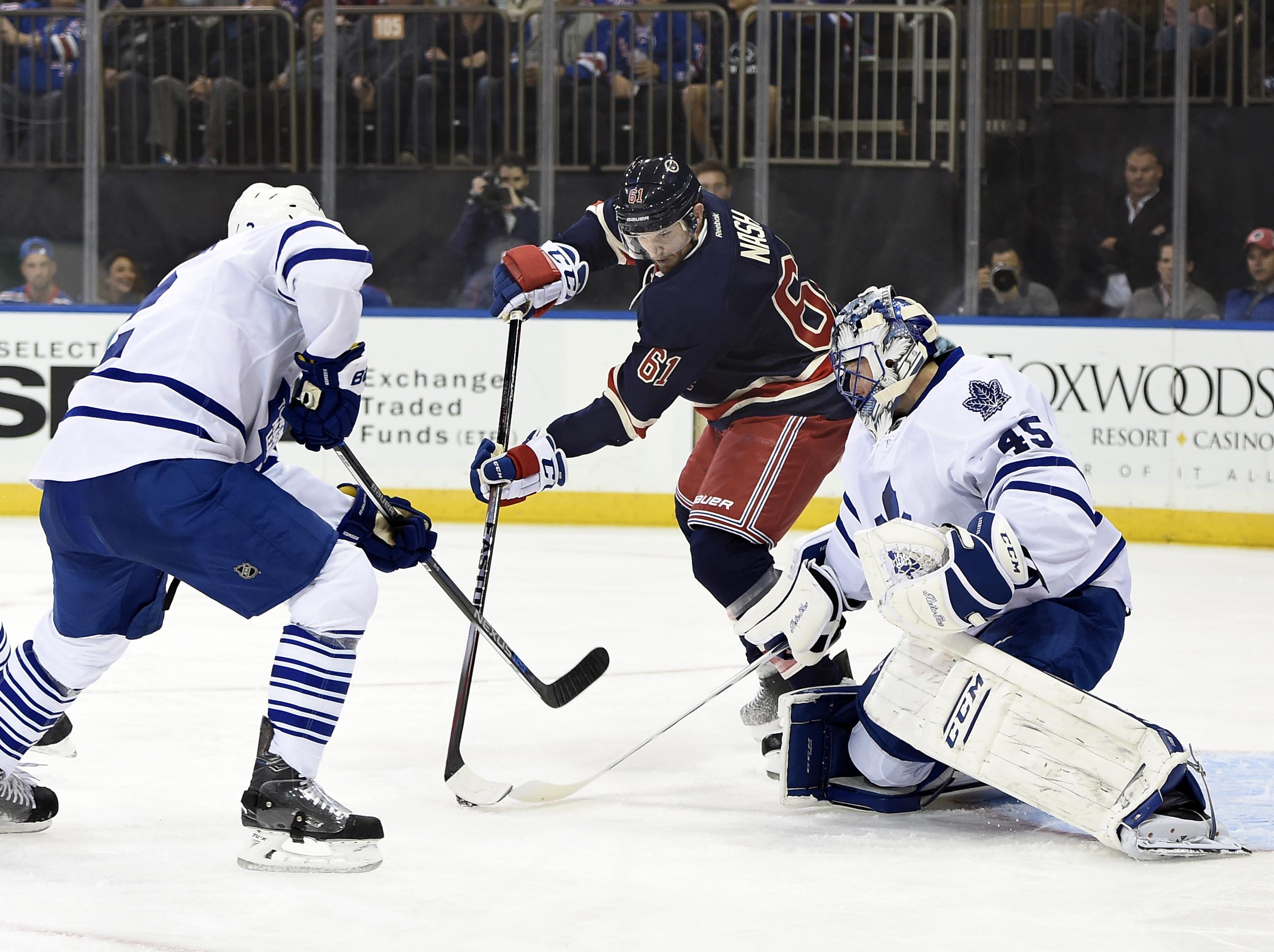 Toronto Maple Leafs defenseman Matt Hunwick (2) and goalie Jonathan Bernier (45) defend the net against New York Rangers left wing Rick Nash (61) during the second period of an NHL hockey game on Friday, Oct. 30, 2015, in New York. (AP Photo/Kathy Kmonice