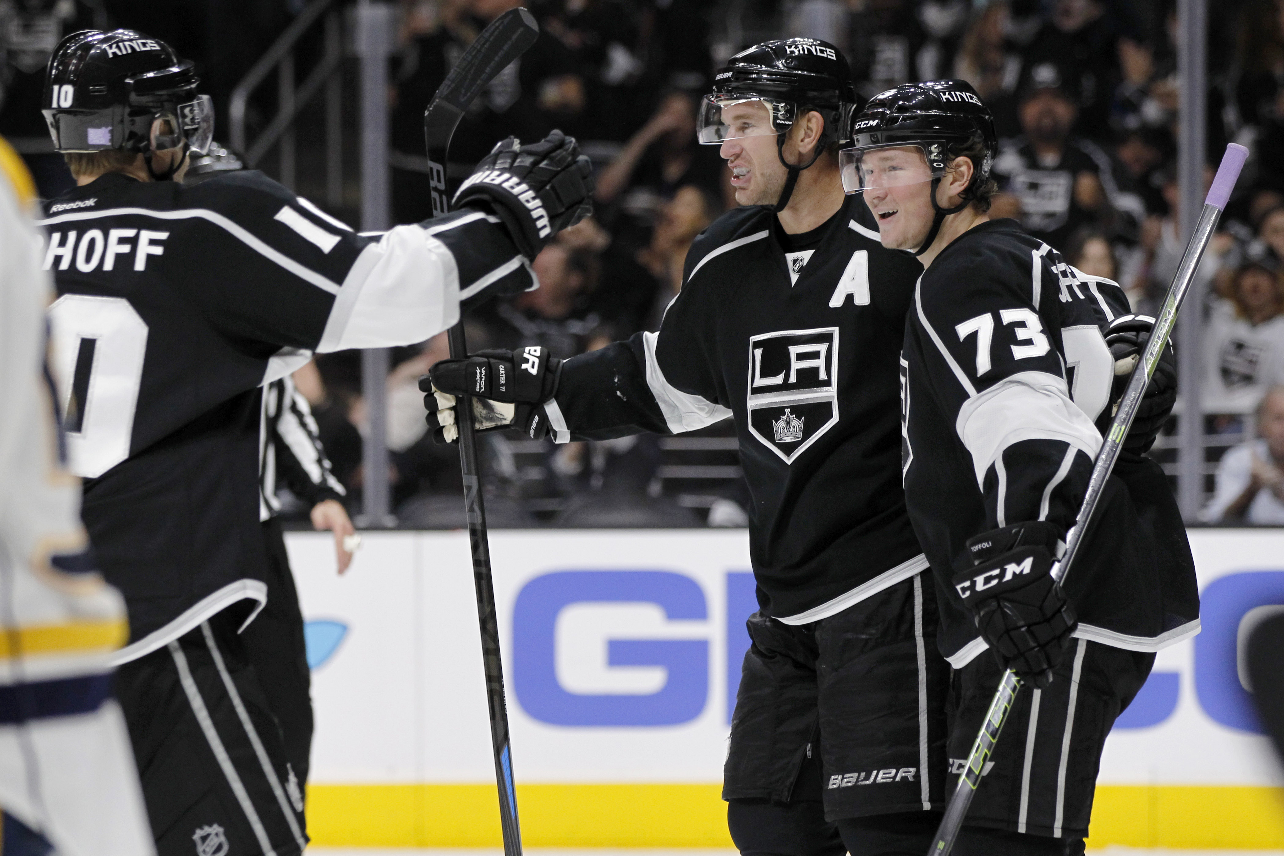 Los Angeles Kings defenseman Christian Ehrhoff (10), of Germany, celebrates with center Jeff Carter, center, on a goal by center Tyler Toffoli (73) during the second period of an NHL hockey game against the Nashville Predators in Los Angeles, Saturday, Oc