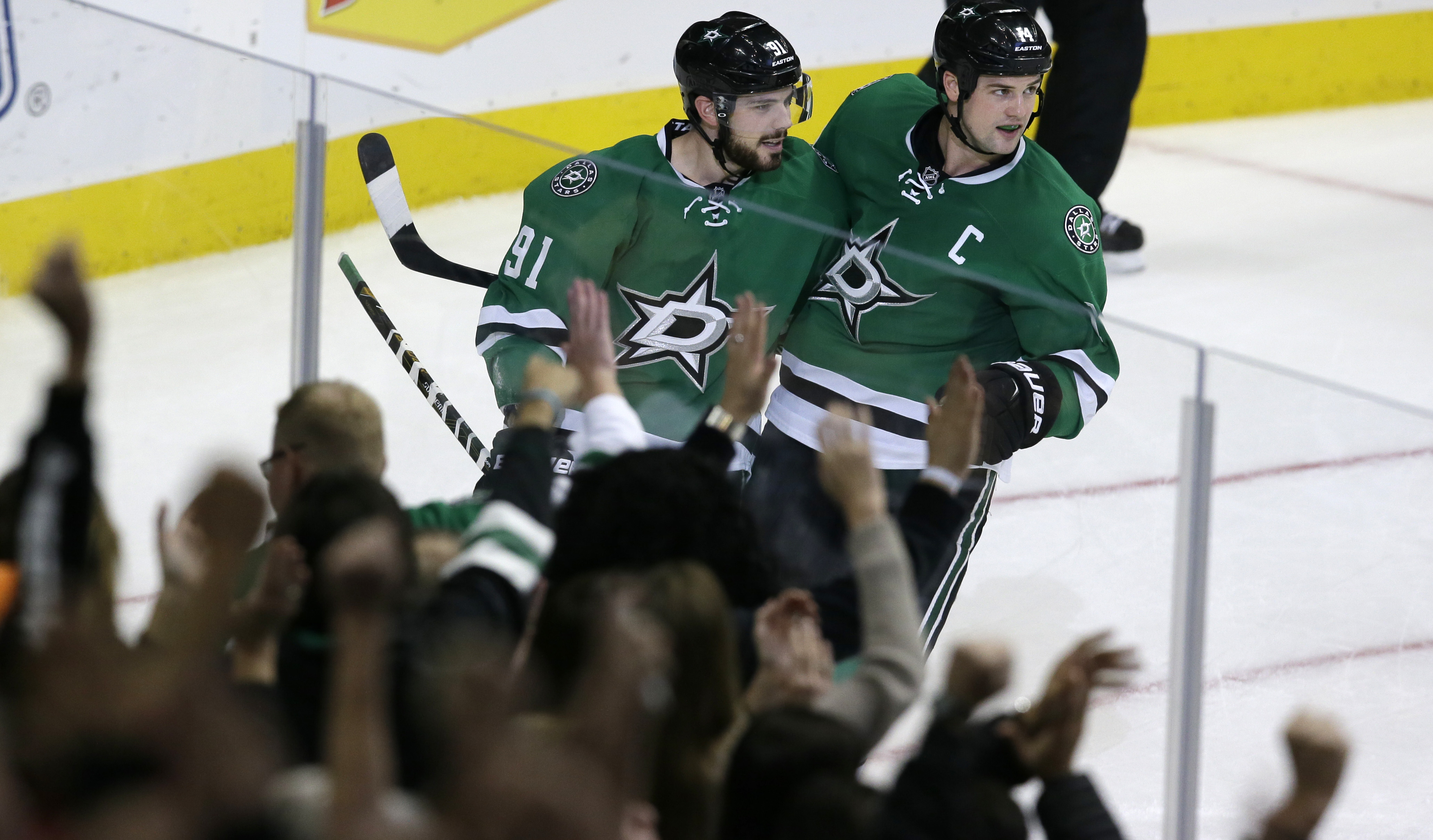 Dallas Stars center Tyler Seguin (91) celebrates his goal with teammate Dallas Stars left wing Jamie Benn (14) during the third period of an NHL hockey game against the San Jose Sharks, Saturday, Oct. 31, 2015, in Dallas. The Stars won 5-3. (AP Photo/LM O