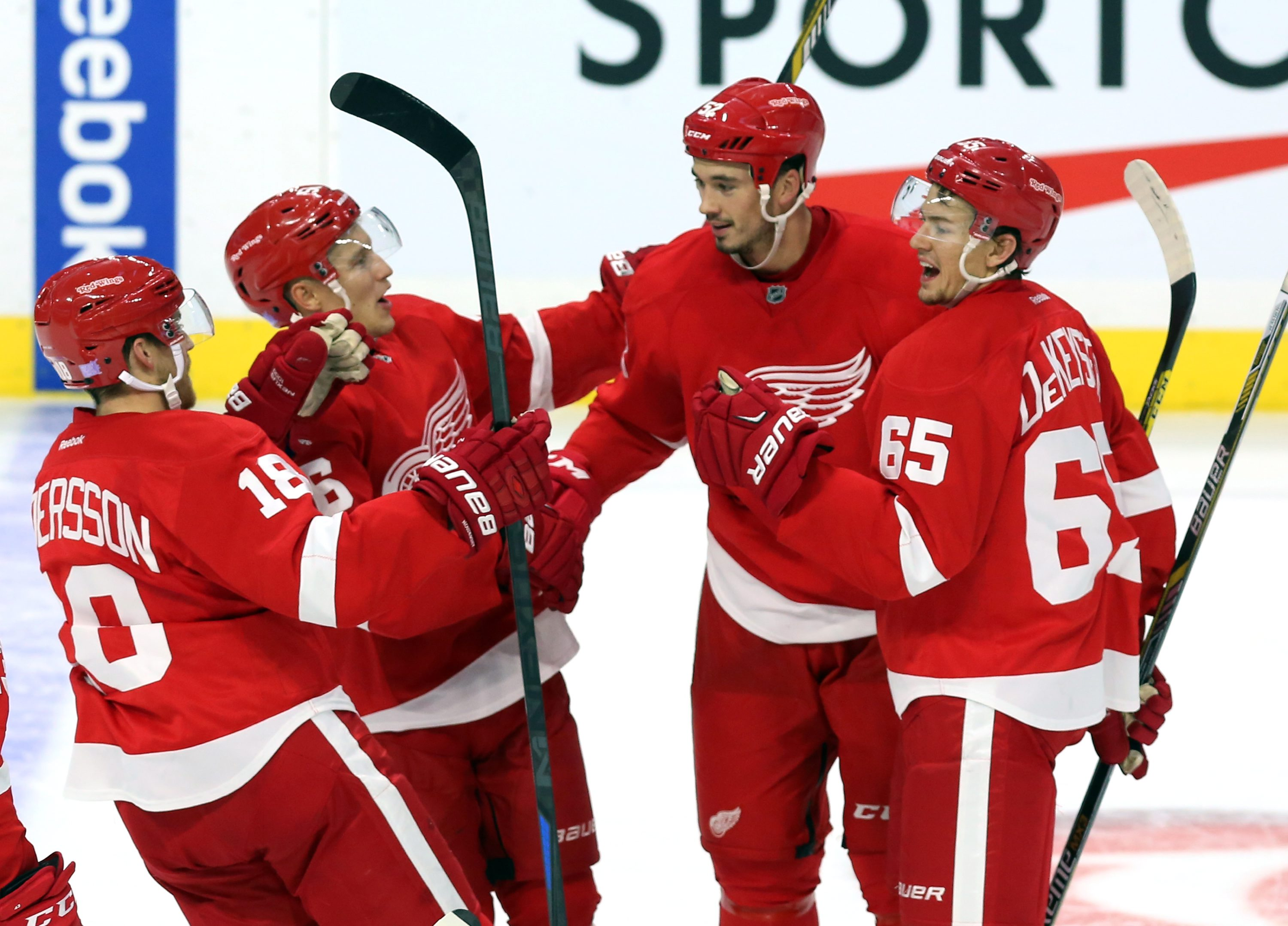 Detroit Red Wings' Jonathan Ericsson (52), second from right, celebrates his goal against the Ottawa Senators with teammates, from left to right, Joakim Andersson (18), Teemu Pulkkinen (56) and Danny DeKeyser (65) during second period NHL hockey action, i