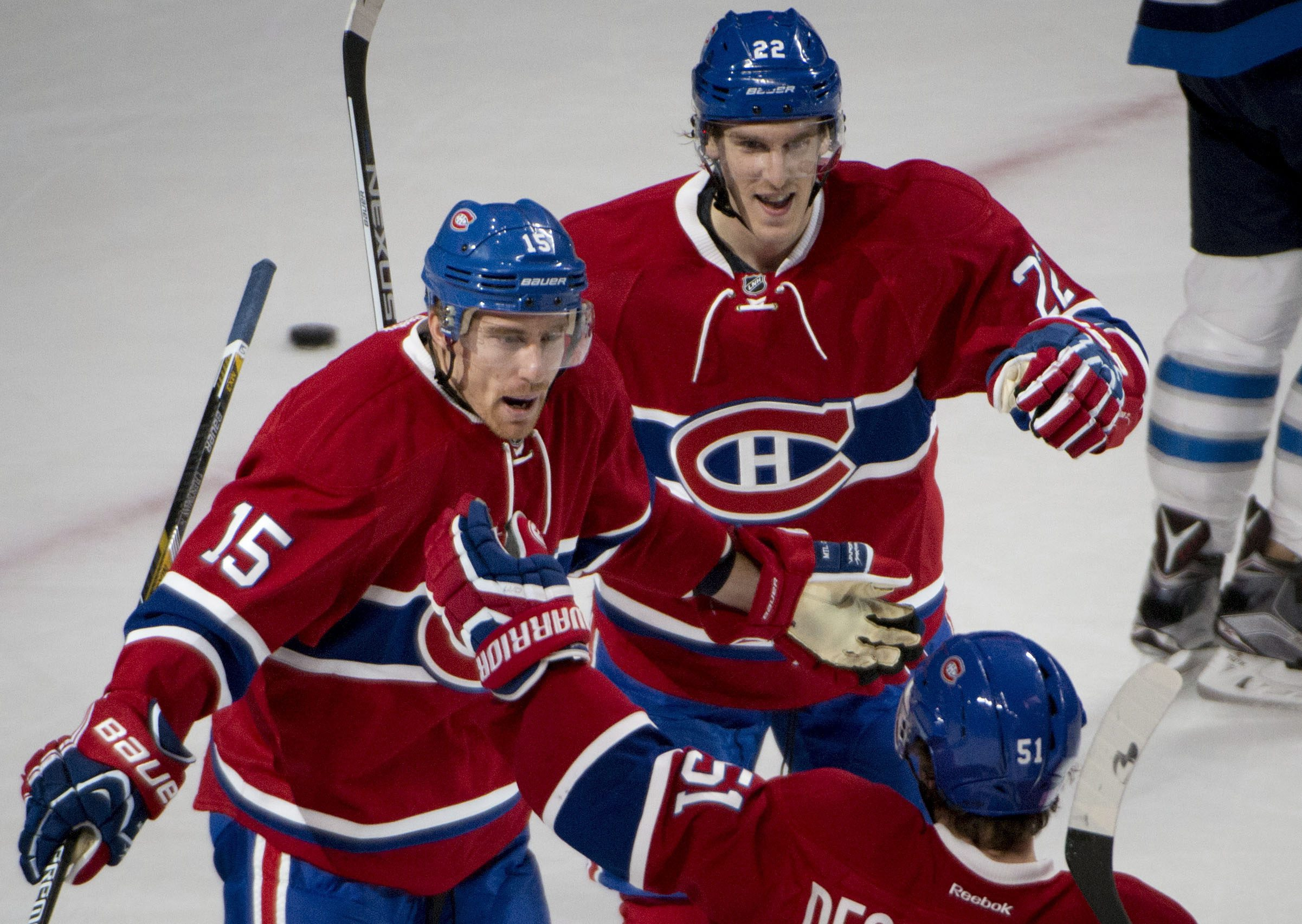 Montreal Canadiens' Tomas Fleischmann (15) celebrates his first period goal against the Winnipeg Jets during NHL action, Sunday, Nov. 1, 2015 in Montreal. (Peter McCabe/The Canadian Press via AP)