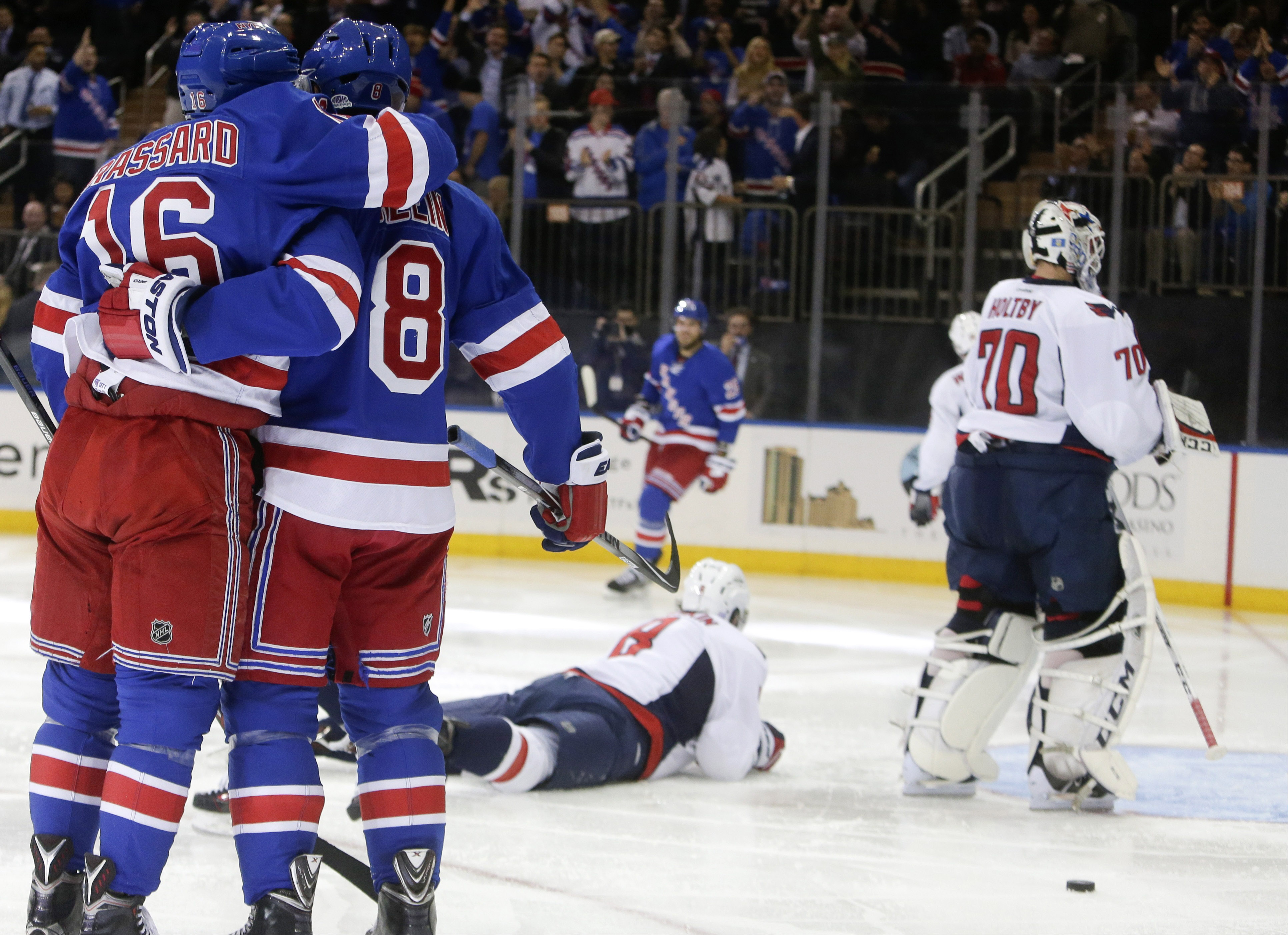 New York Rangers' Kevin Klein (8) celebrates his goal with teammate Derick Brassard (16) as Washington Capitals' Alex Ovechkin (8) and goalie Braden Holtby (70) look away during the second period of an NHL hockey game Tuesday, Nov. 3, 2015, in New York. (