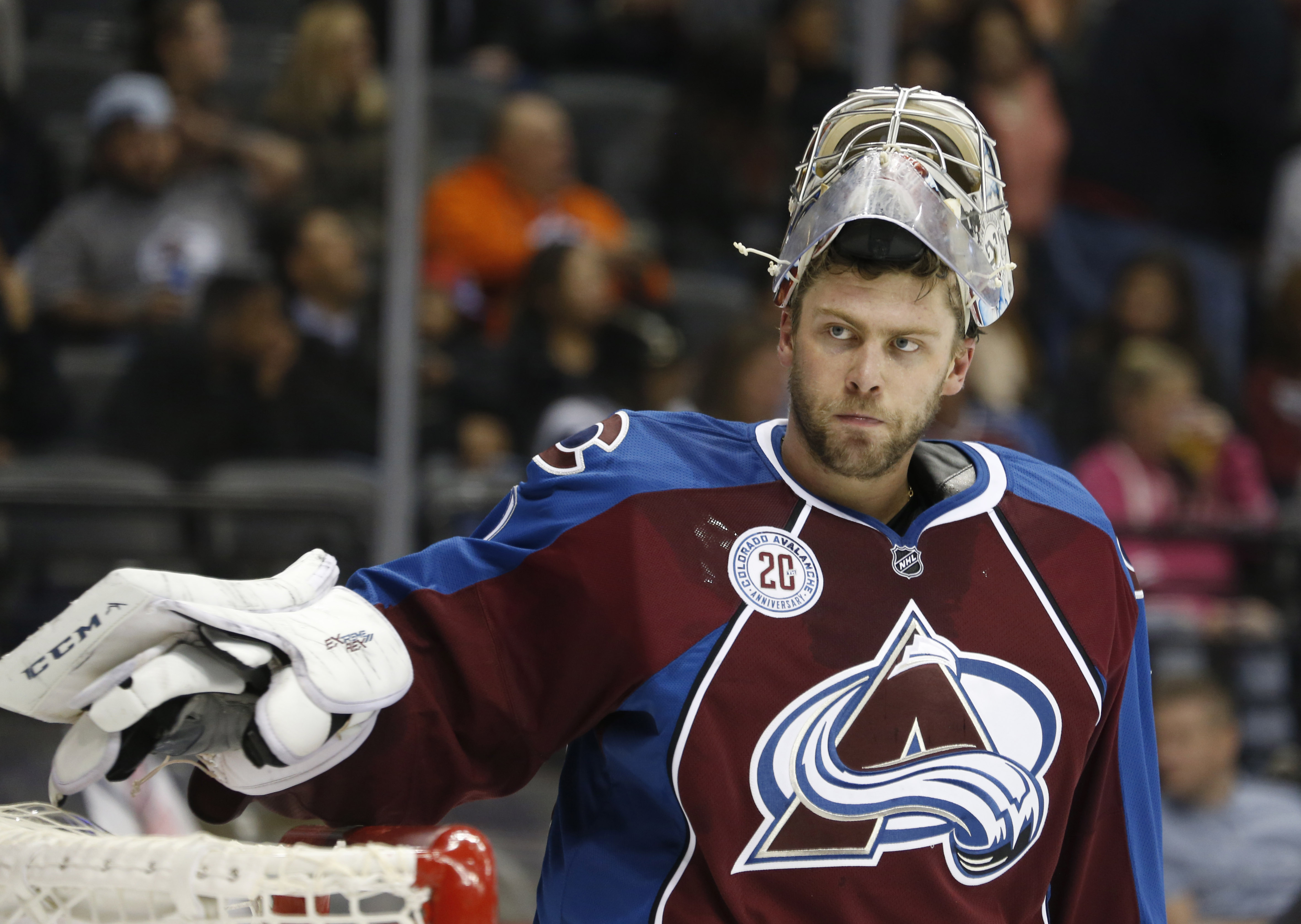 Colorado Avalanche goalie Semyon Varlamov, of Russia, waits during a timeout in the second period of  the team's NHL hockey game against the Calgary Flames on Tuesday, Nov. 3, 2015, in Denver. (AP Photo/David Zalubowski)