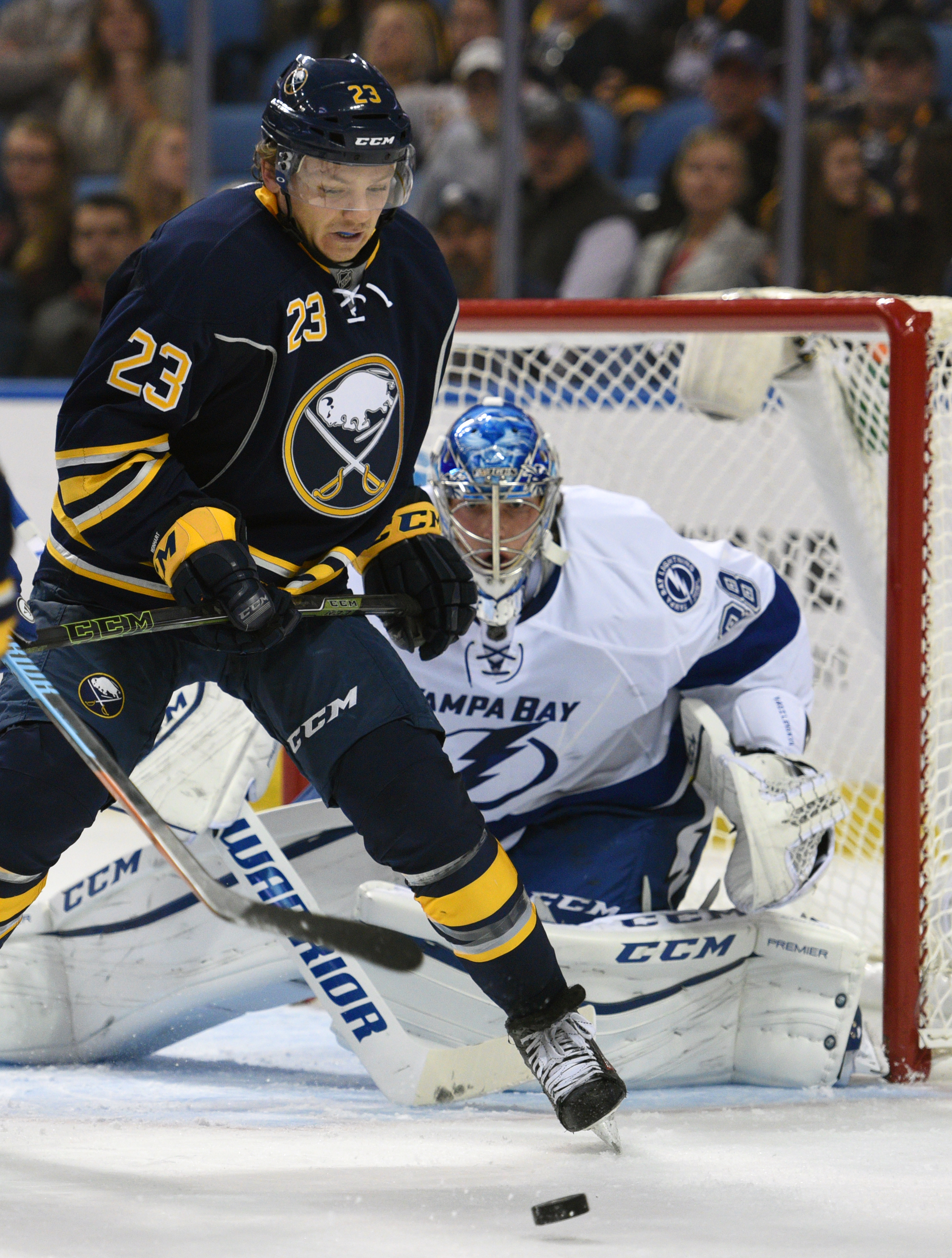 Buffalo Sabres center Sam Reinhart (23) battles for the puck in front of Tampa Bay Lightning goaltender Andrei Vasilevskiy (88), of Russia, during the first period of an NHL hockey game, Thursday Nov. 5, 2015, in Buffalo, N.Y. (AP Photo/Gary Wiepert)