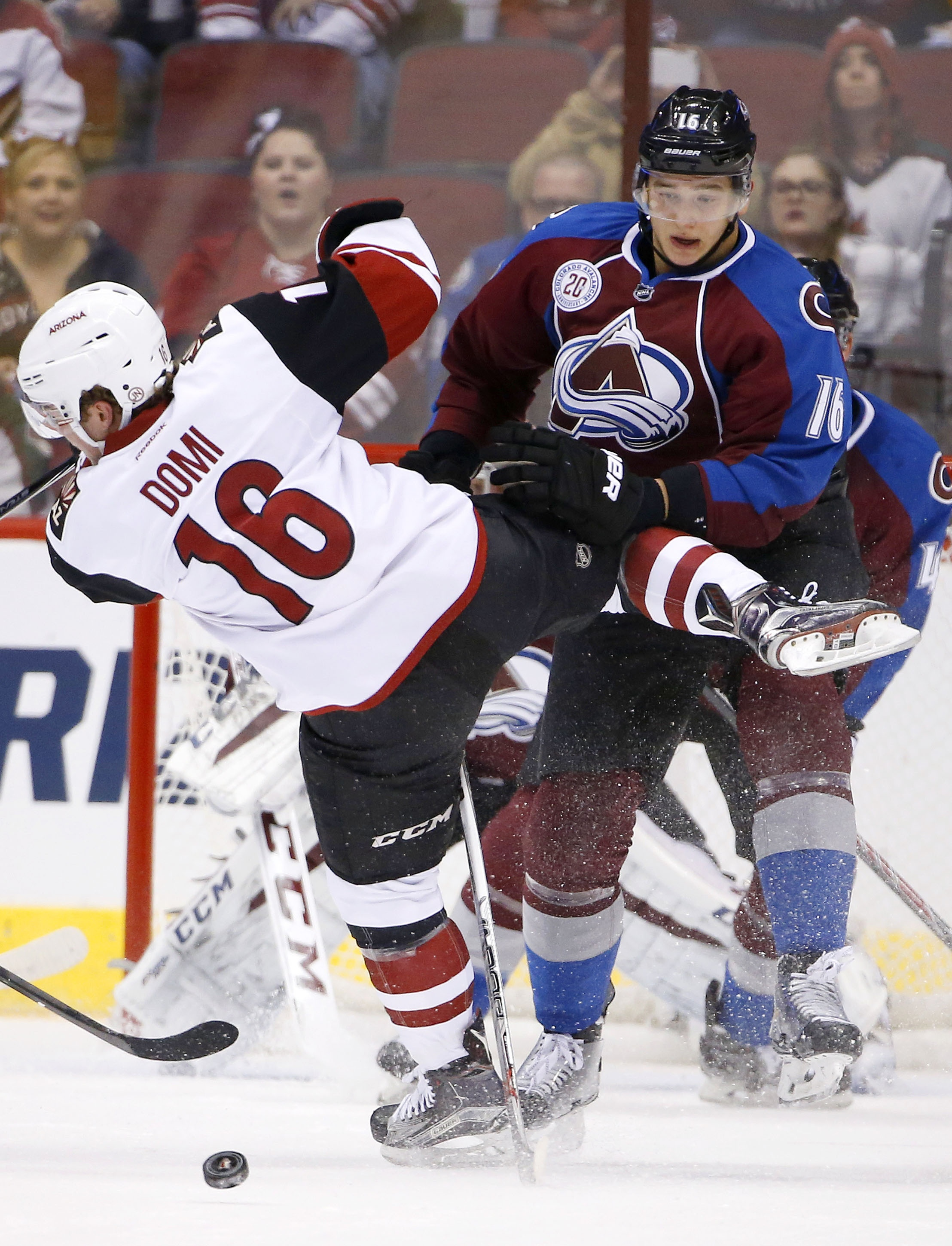 Colorado Avalanche's Nikita Zadorov, right, of Russia, checks Arizona Coyotes' Max Domi, left, off the puck during the first period of an NHL hockey game Thursday, Nov. 5, 2015, in Glendale, Ariz. (AP Photo/Ross D. Franklin)