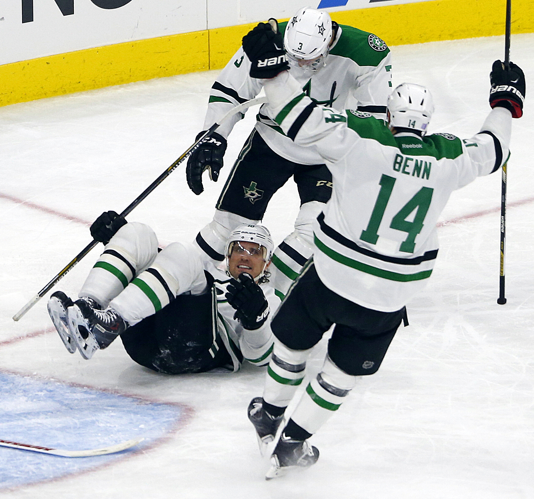 Dallas Stars' Patrick Sharp, on his back on the ice, celebrates his go-ahead goal with teammates Jamie Benn (14) and John Klingberg (3) during the third period of an NHL hockey game against the Carolina Hurricanes, Friday, Nov. 6, 2015, in Raleigh, N.C. D