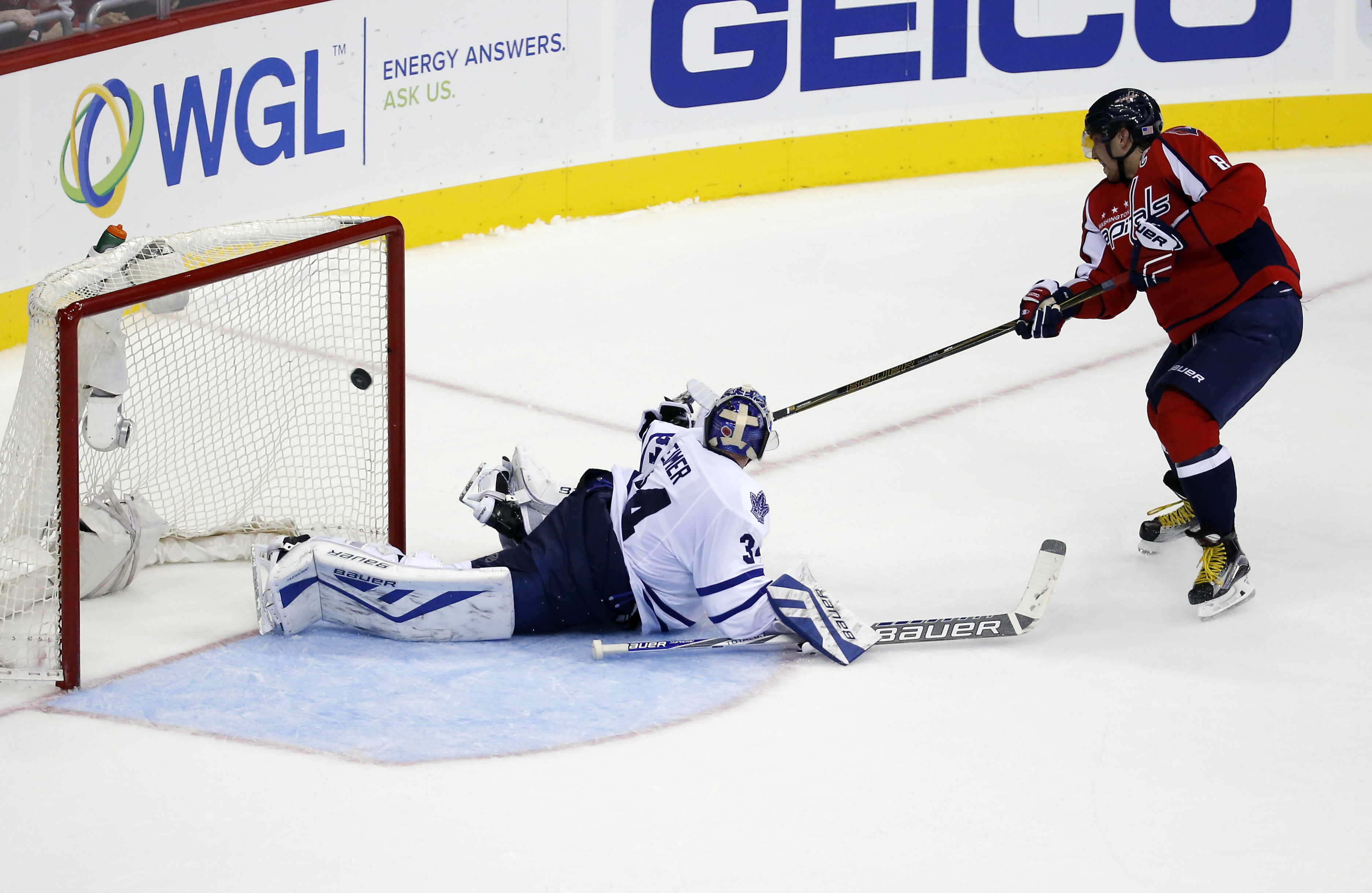 Washington Capitals left wing Alex Ovechkin (8), from Russia, scores the winning goal past Toronto Maple Leafs goalie James Reimer (34) in the shootout portion of an NHL hockey game, Saturday, Nov. 7, 2015, in Washington. The Capitals won 3-2 in overtime.