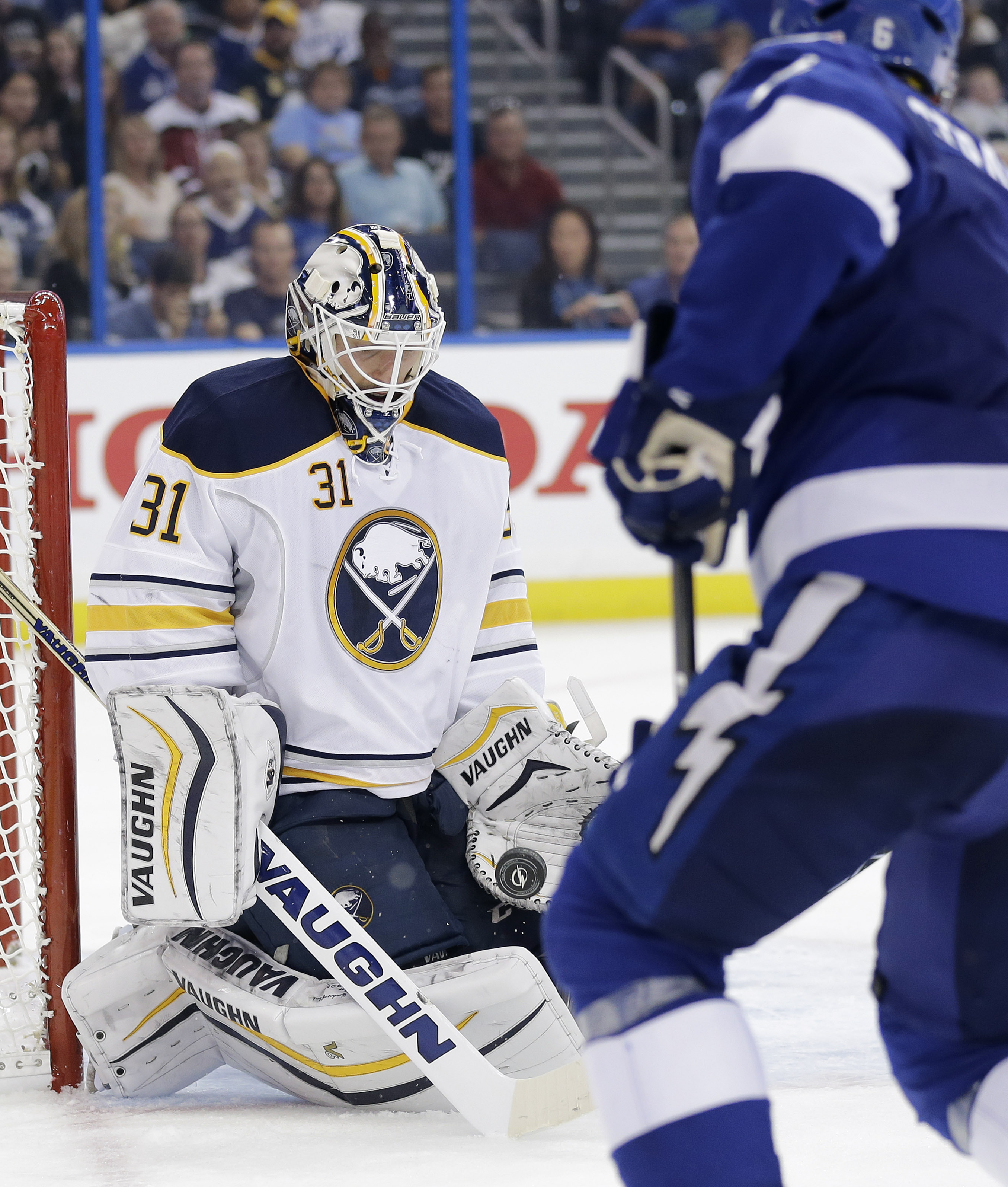 Buffalo Sabres goalie Chad Johnson (31) makes a save on a shot by Tampa Bay Lightning defenseman Anton Stralman during the second period of an NHL hockey game Tuesday, Nov. 10, 2015, in Tampa, Fla. (AP Photo/Chris O'Meara)