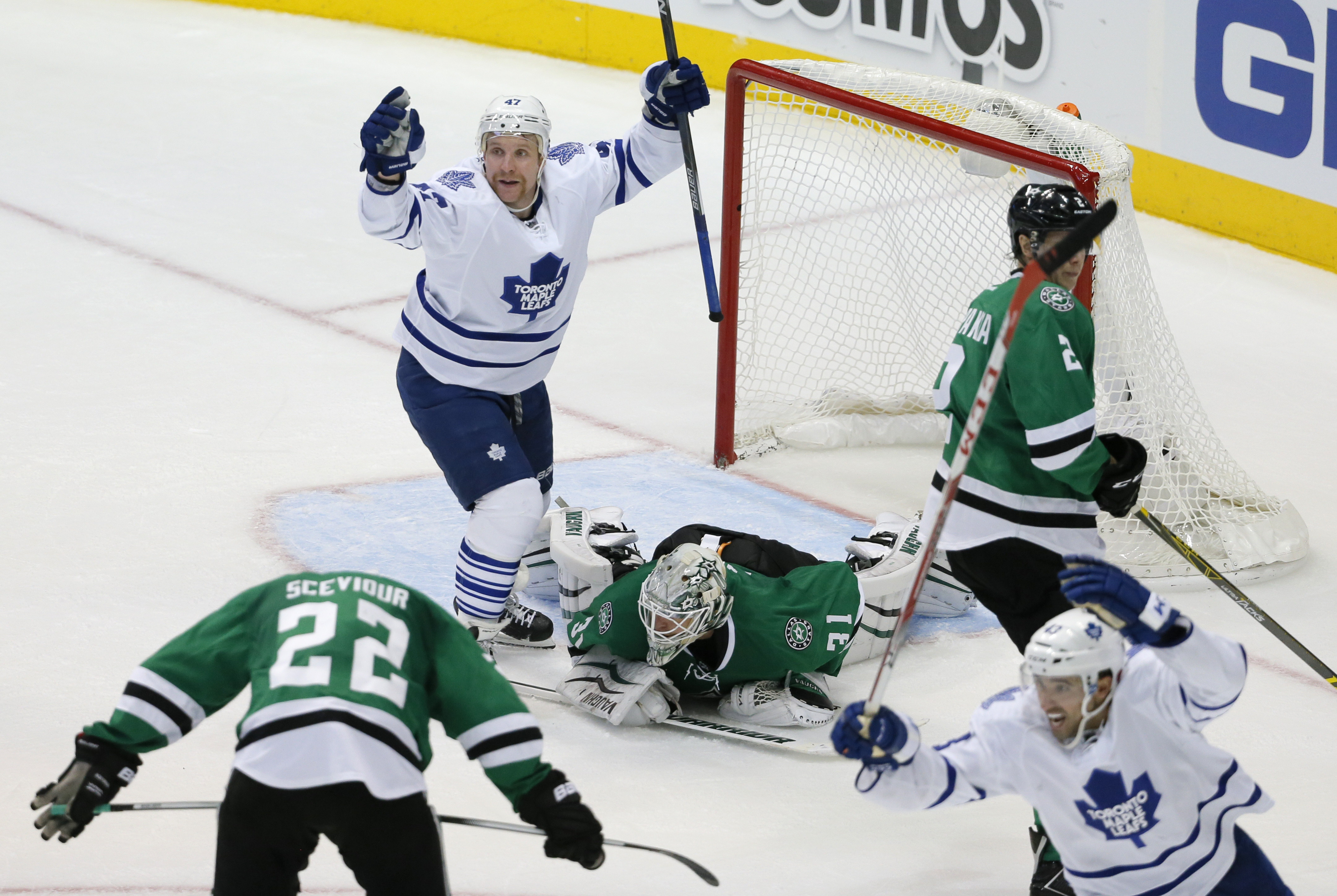 Toronto Maple Leafs' Leo Komarov (47) and Nazem Kadri (43) celebrate a goal by Jake Gardiner, as Dallas Stars' Colton Sceviour (22), Antti Niemi (31) and Jyrki Jokipakka (2) of Finland react to the score during the third period of an NHL hockey game Tuesd