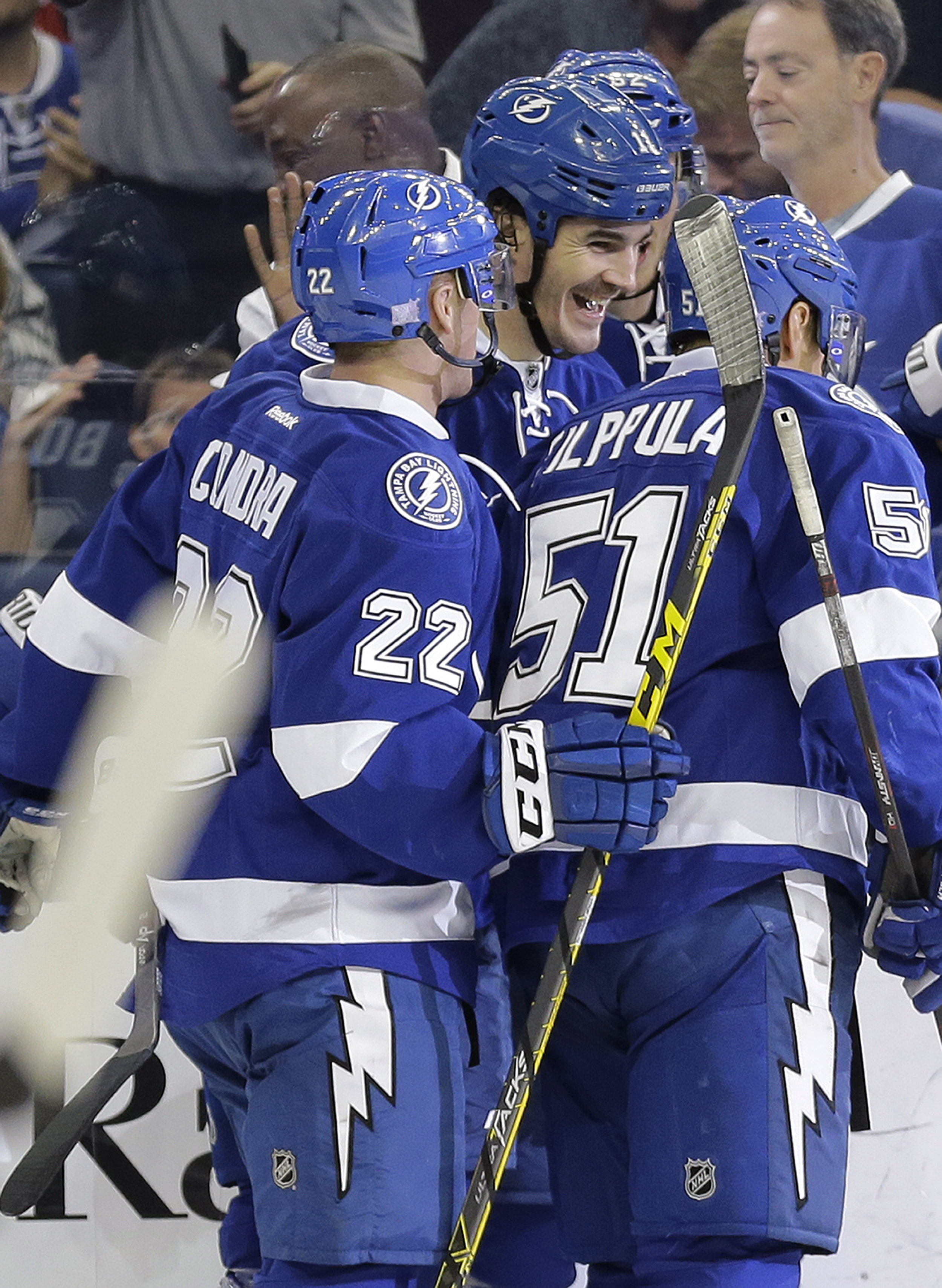 Tampa Bay Lightning center Brian Boyle (11) celebrates his goal against the Calgary Flames with right wing Erik Condra (22) and center Valtteri Filppula (51), of Finland, during the second period of an NHL hockey game Thursday, Nov. 12, 2015, in Tampa, Fl